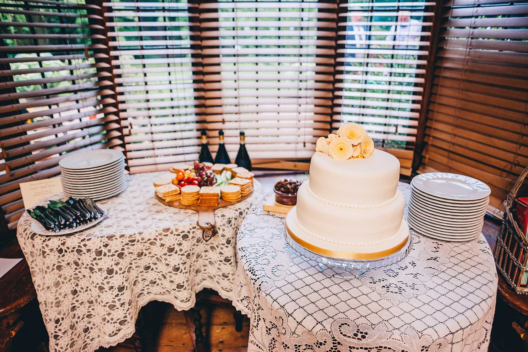 Wedding cake in front of bay windows