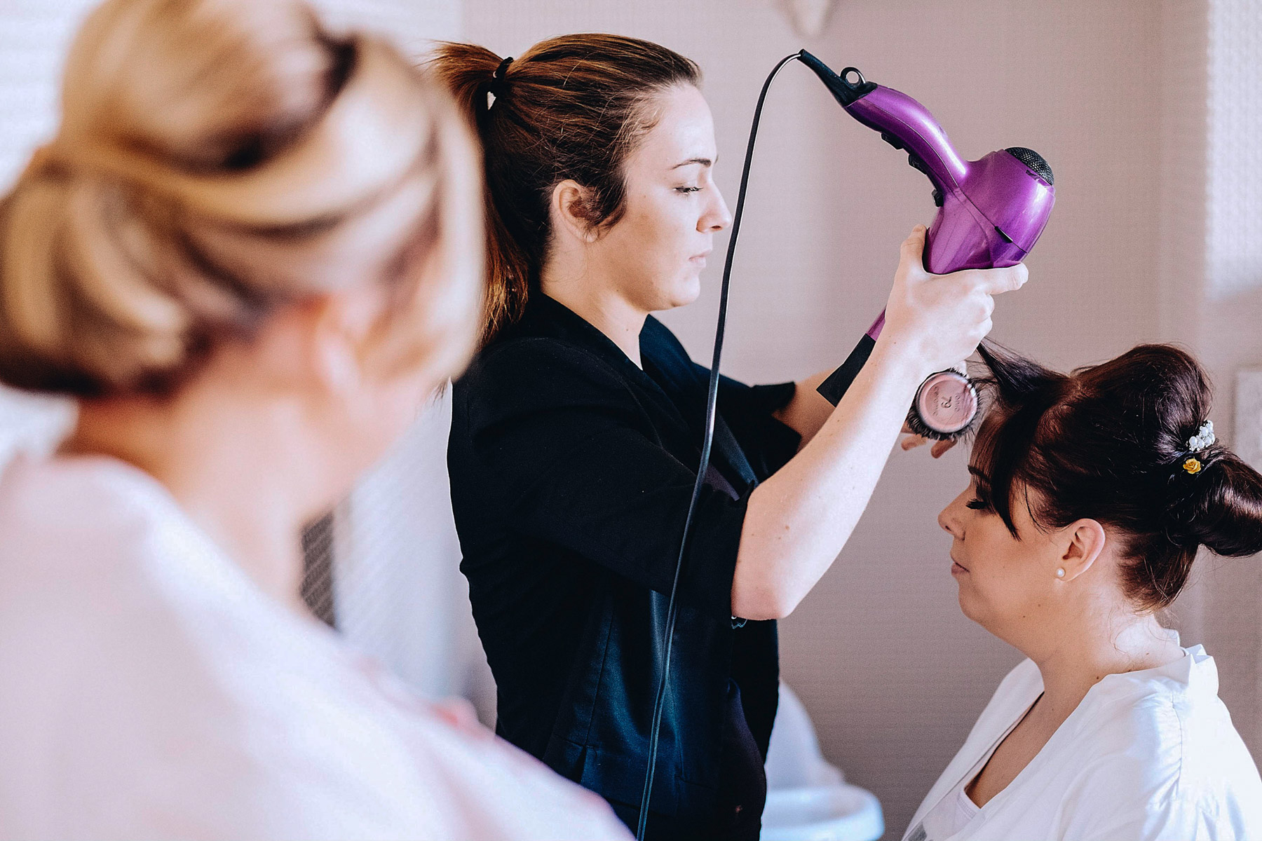 Bride getting her hair styled by a hairdresser