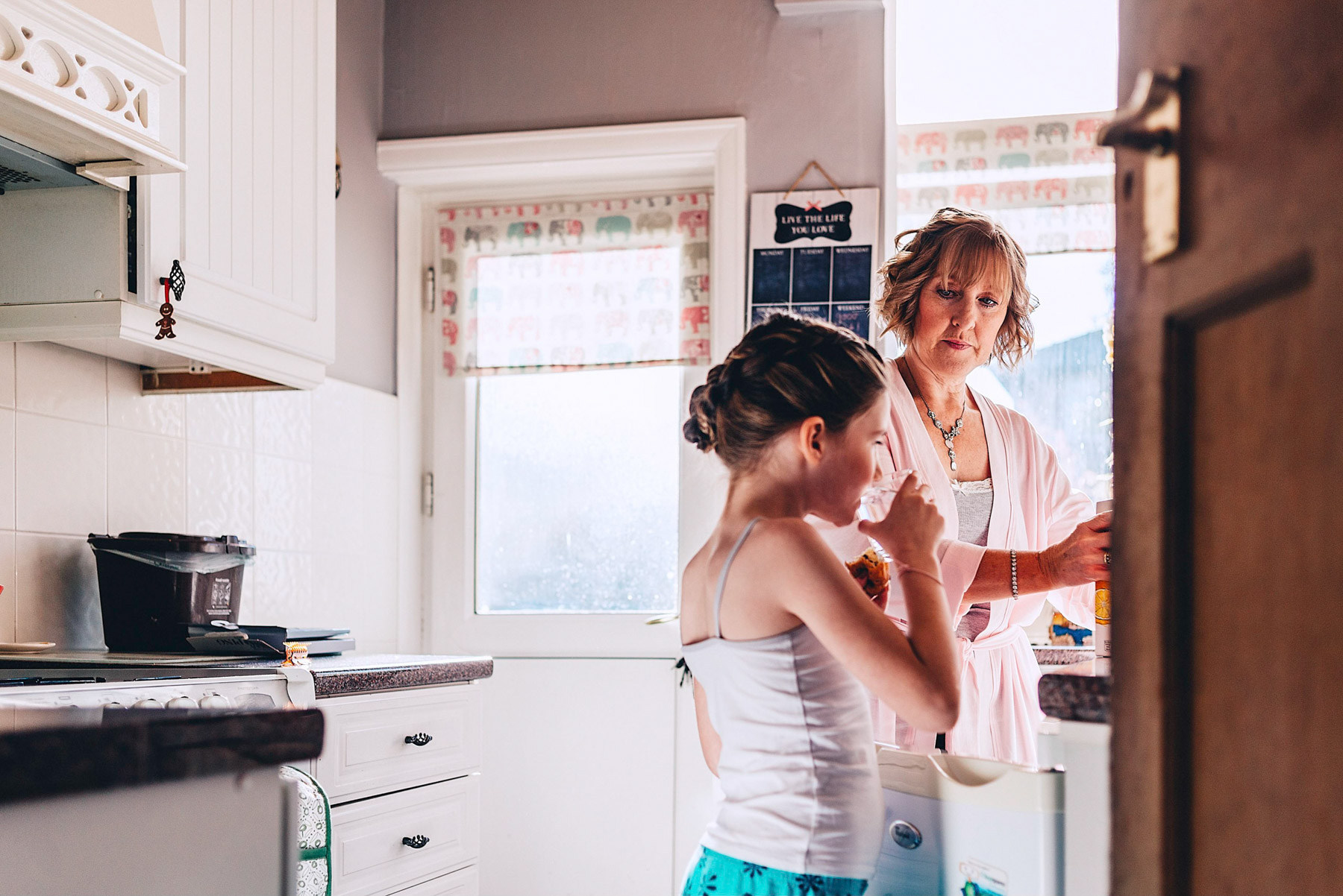 Young girl and woman in the kitchen