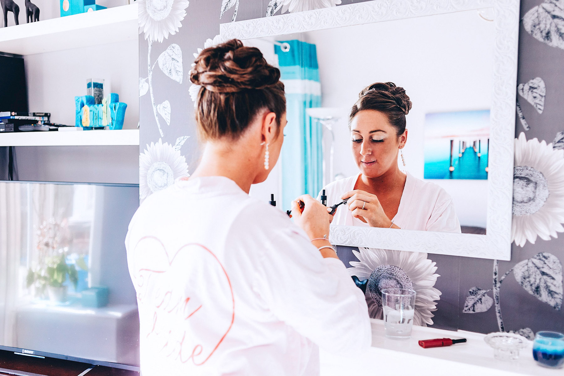 Bridesmaid looks at herself in the mirror