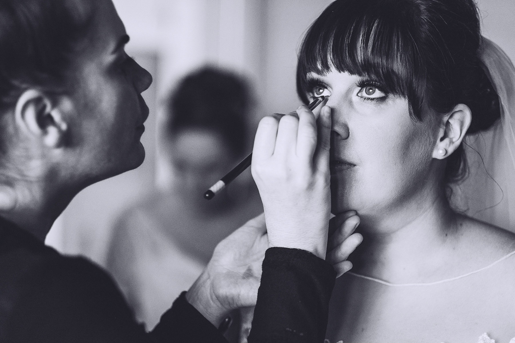 Make up is applied to brides eyes