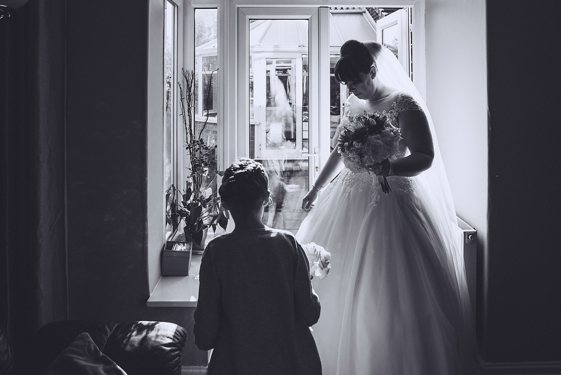 silhouette of daughter and bride