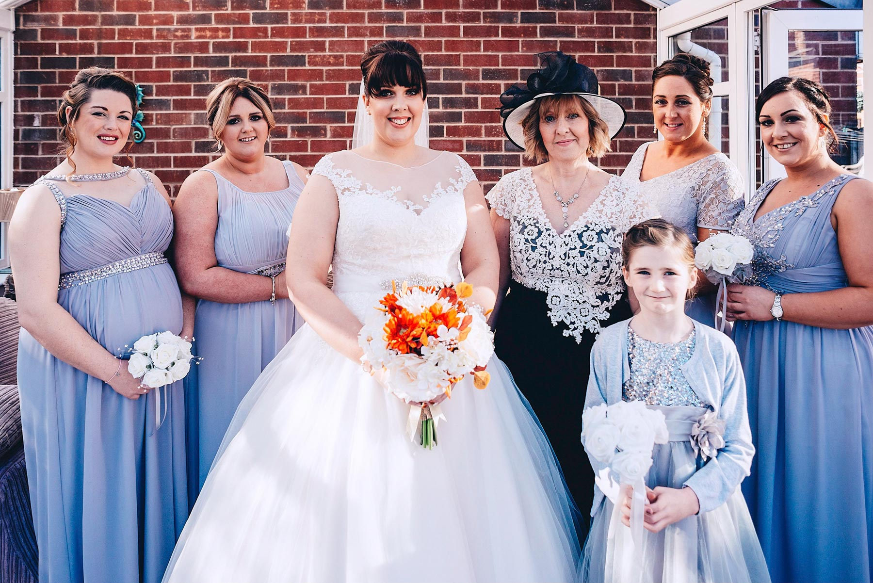 Wedding party pose for photo