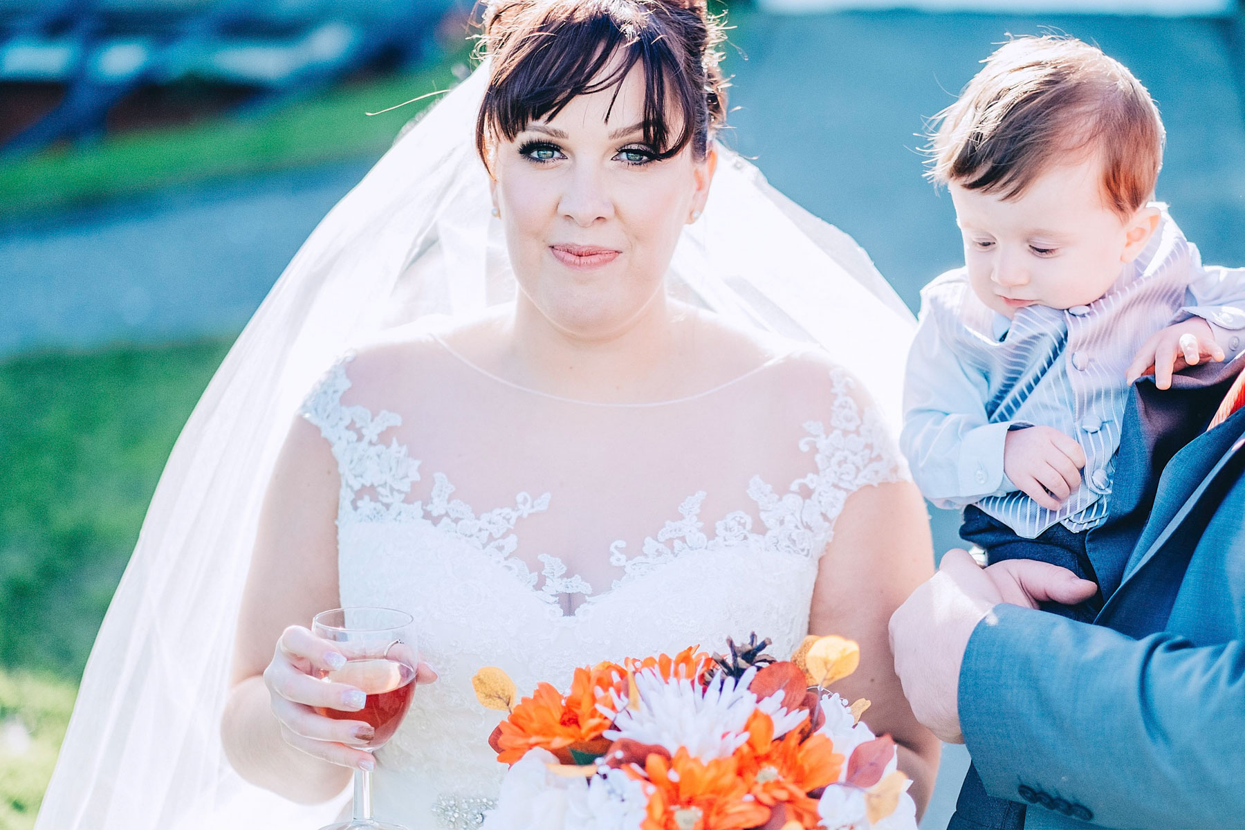 Bride looks towards the camera while light envelops her
