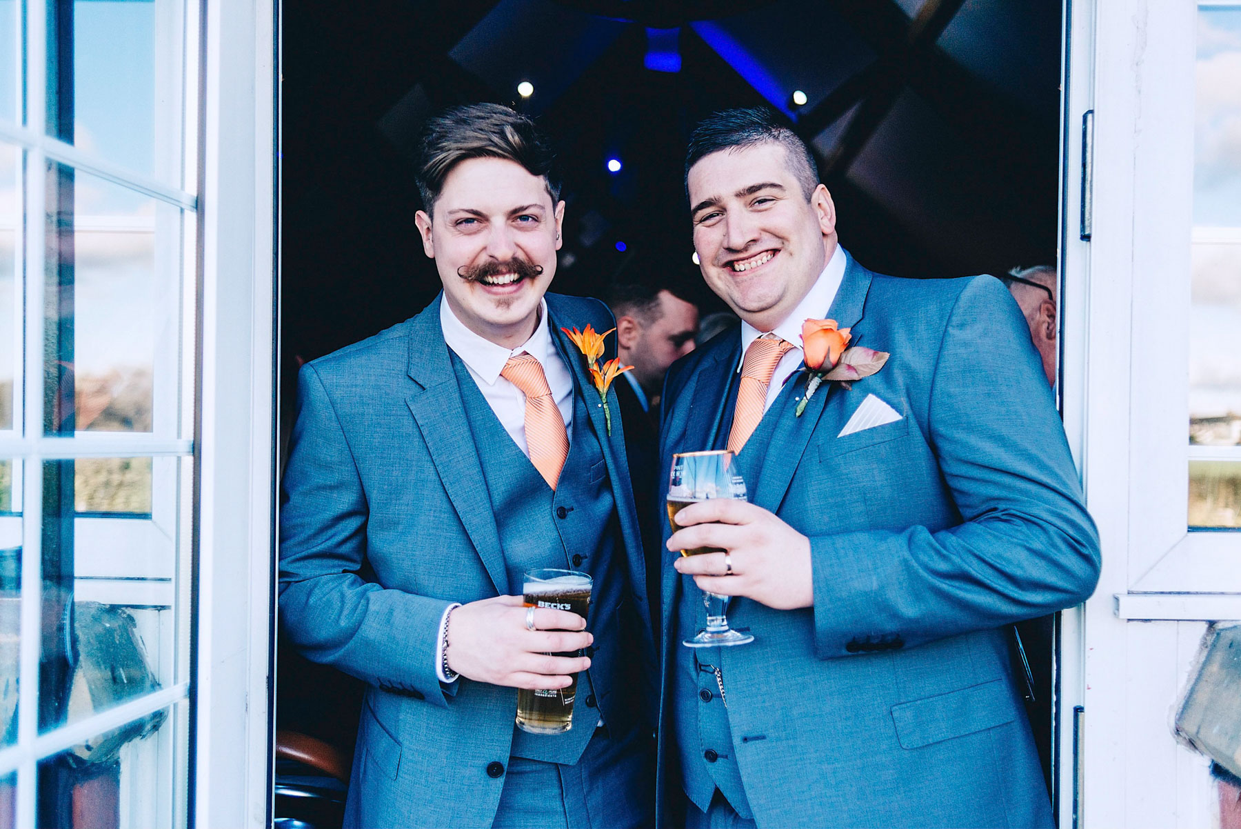 Groom and best man pose for photo