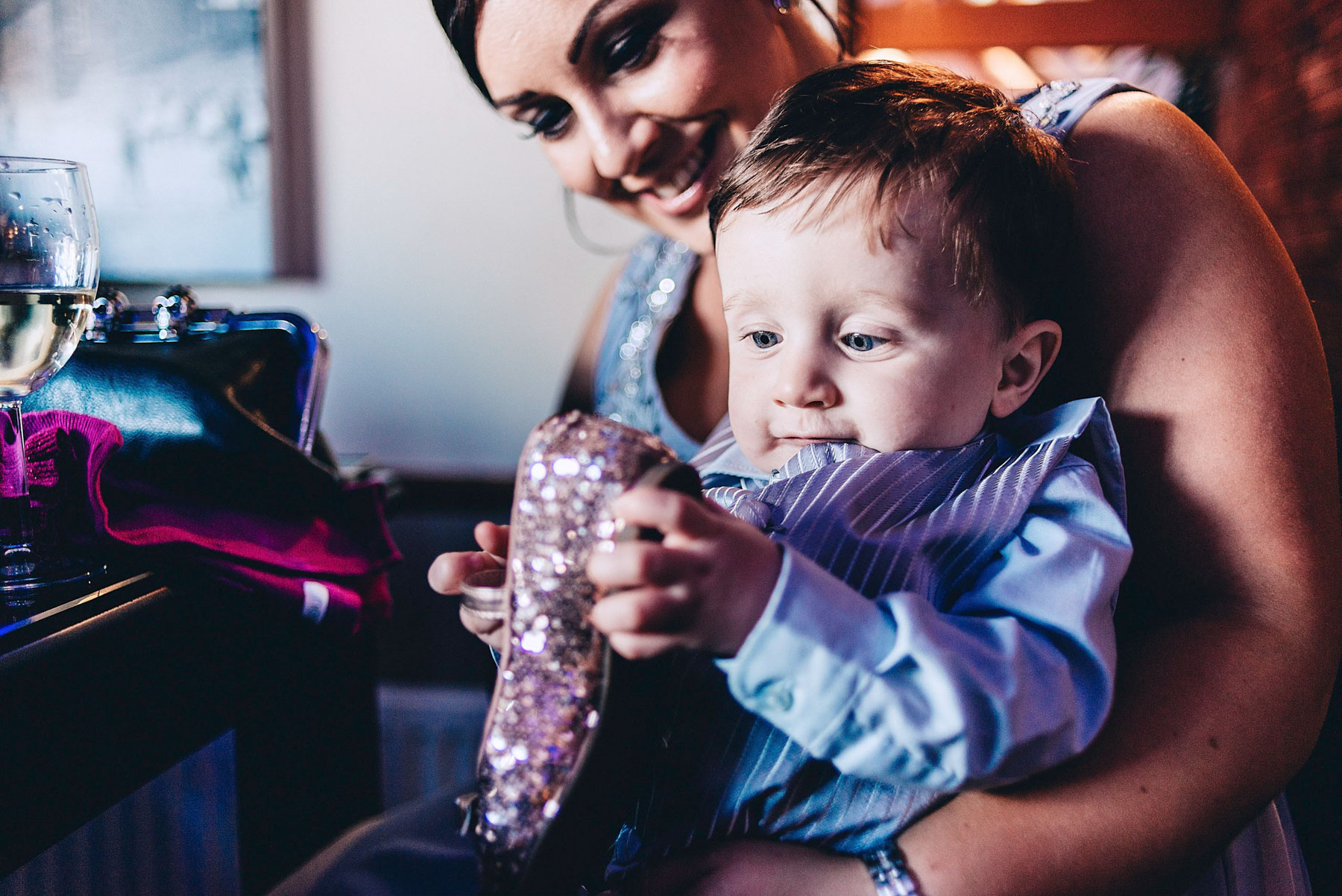 Brides son plays with sparking shoe
