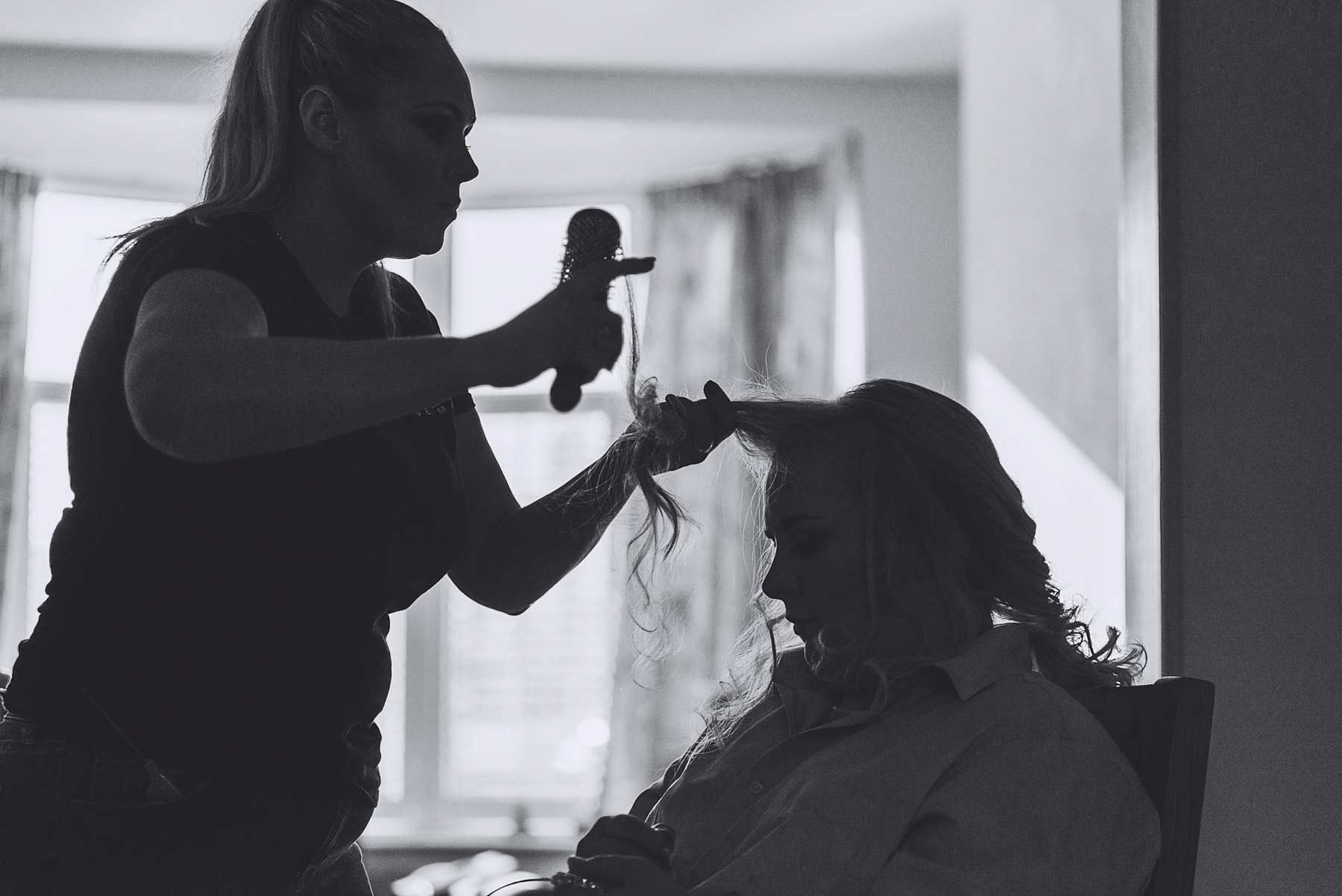 silhouette of bride's hair being styled