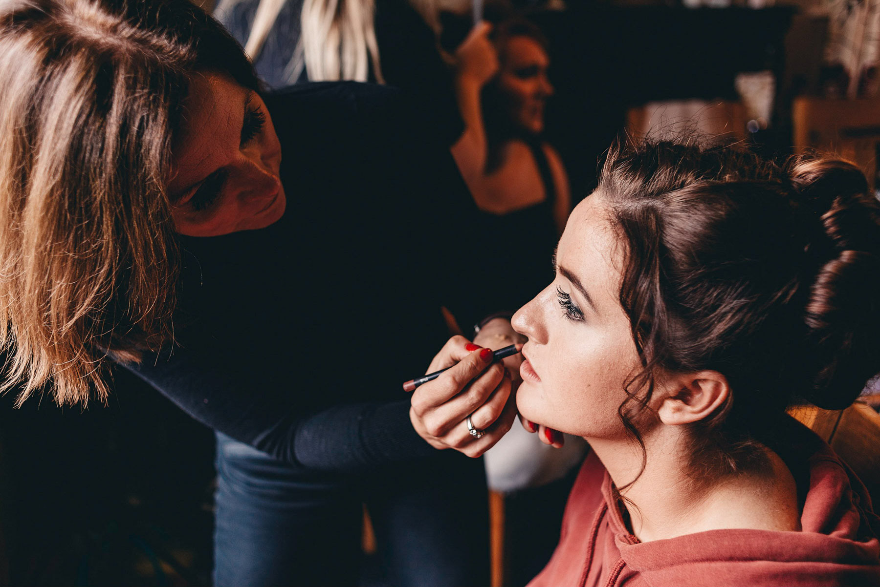 Bridesmaid has her makeup applied