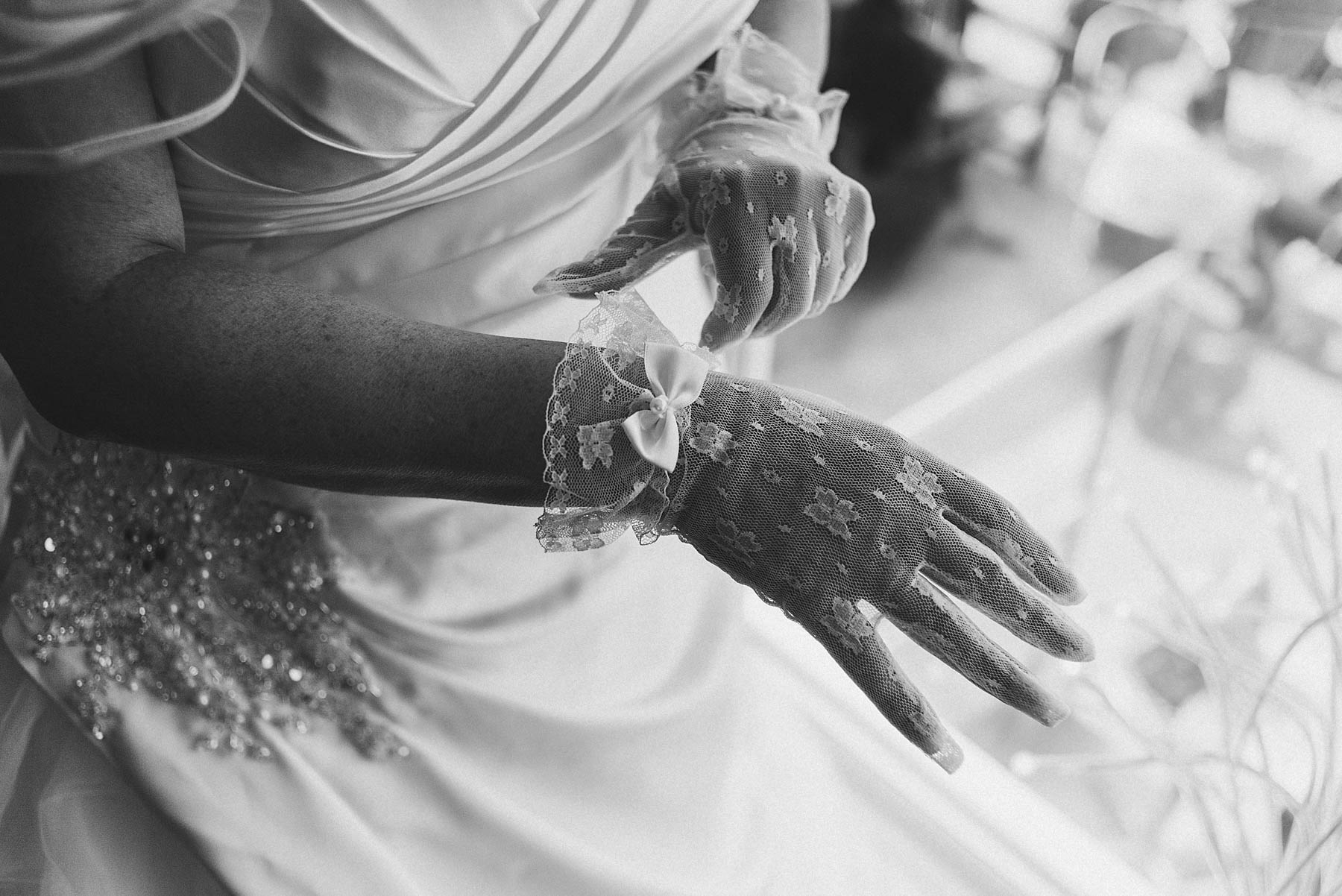 Bride shows her gloves