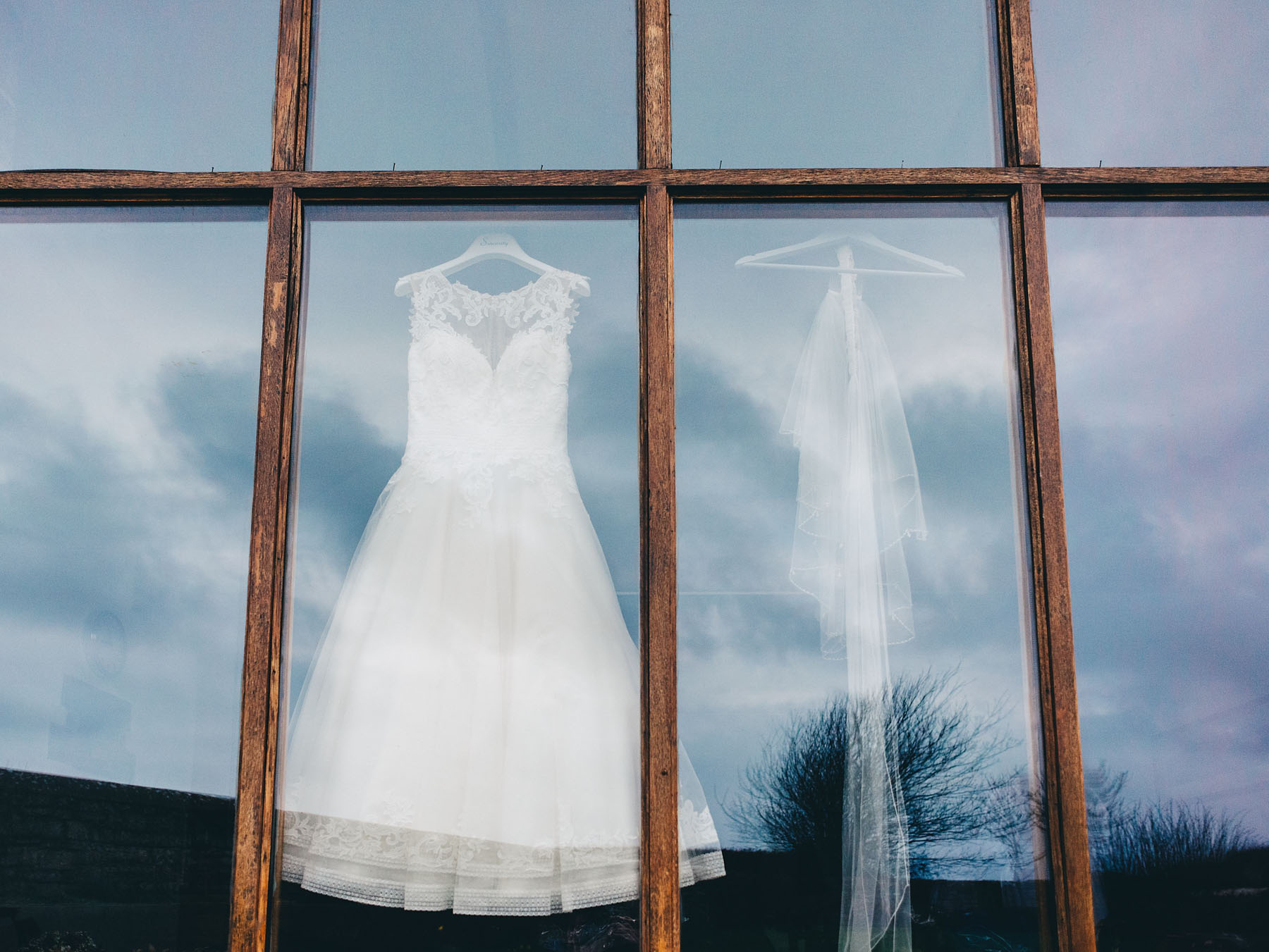Wedding dress hung up in window