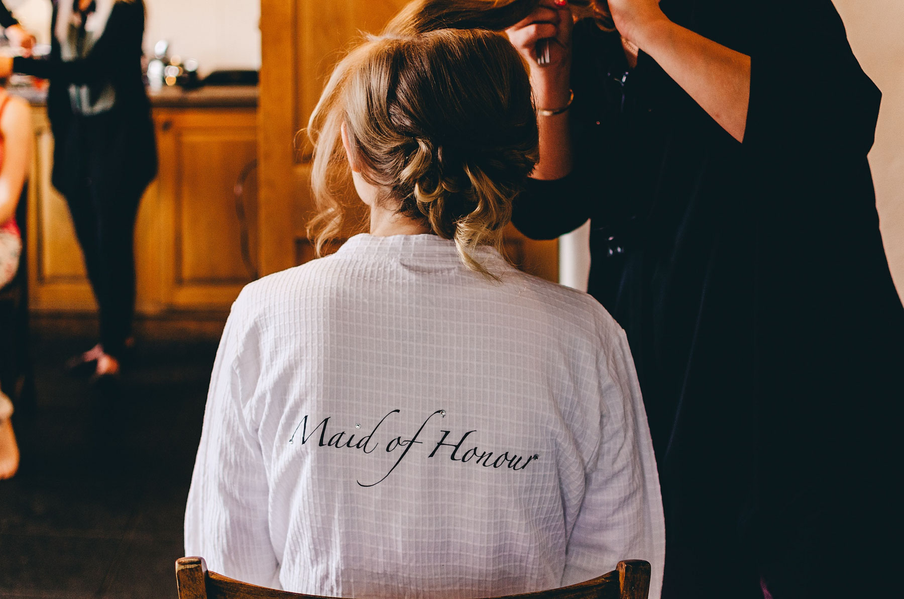 Bridesmaid getting her hair ready for wedding