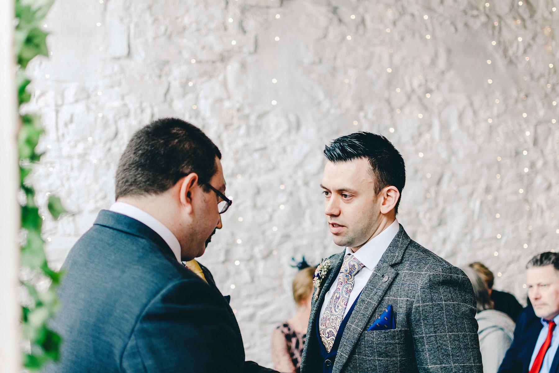 Groom talks to friend before service starts