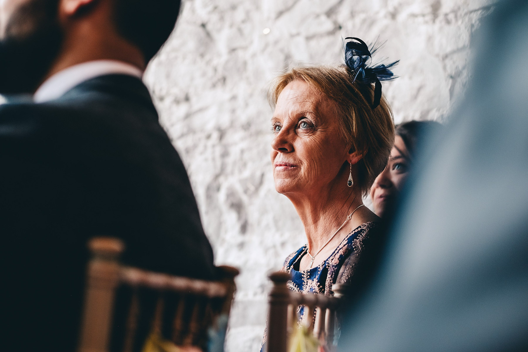 Mother of the groom looks on at wedding