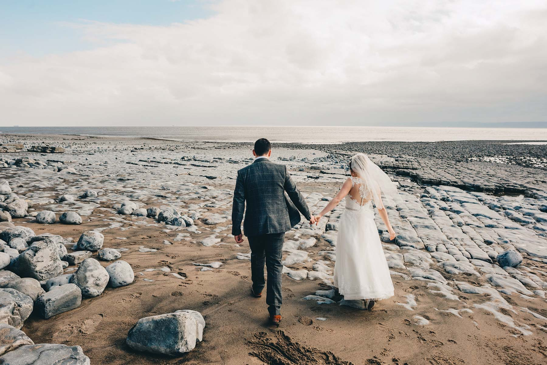 Bride and Groom walk out to the coast in Llantwit Major, South Wales