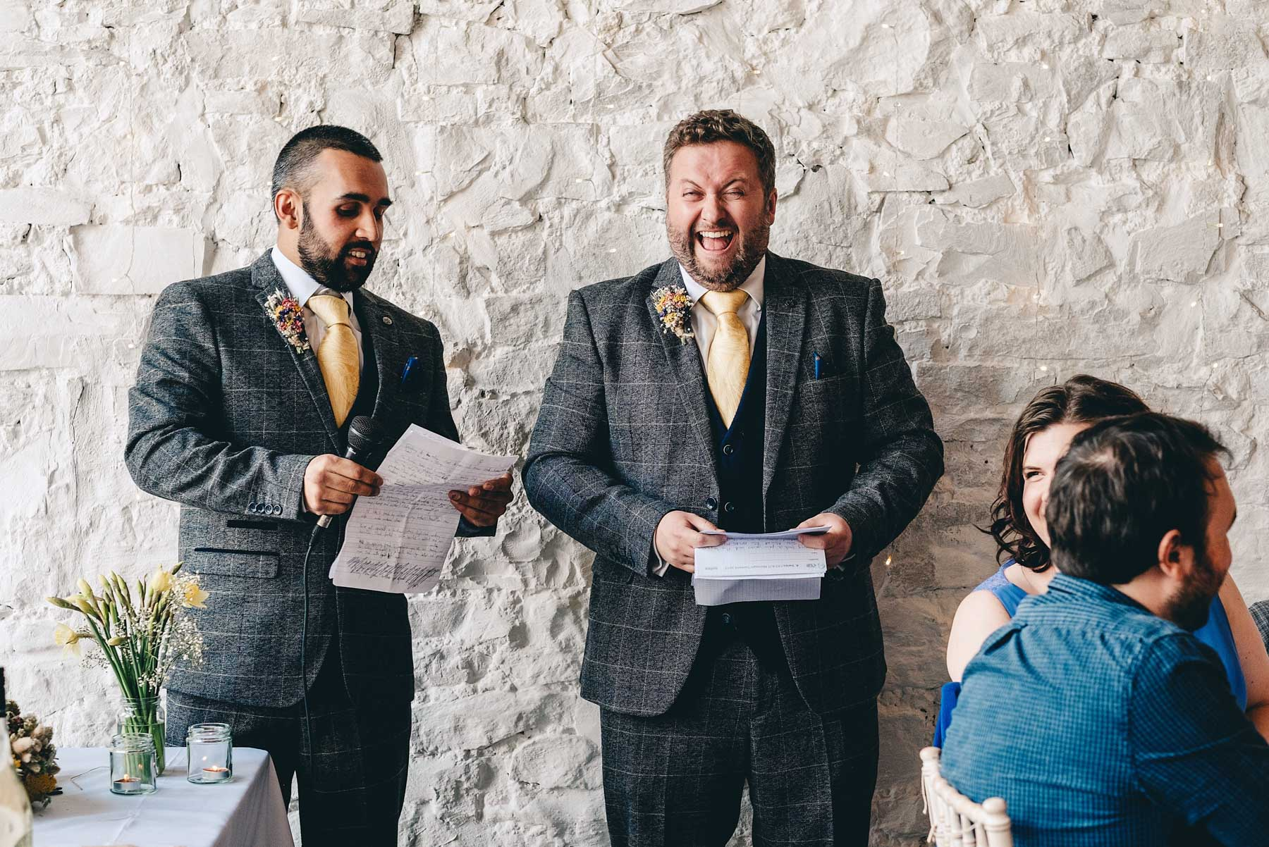Best man laughs as he gives his speech at Rosedew Farm, Llantwit Major, South Wales