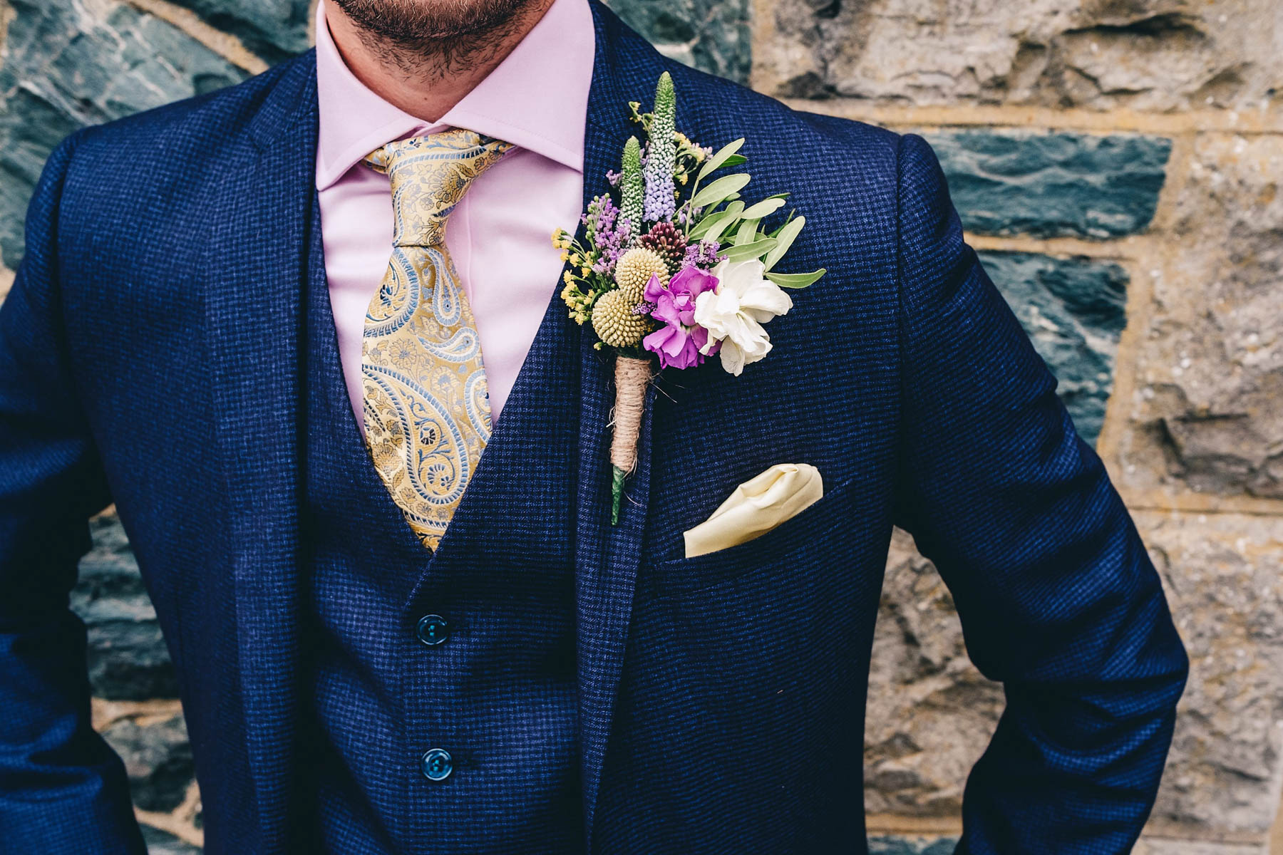 Close up of grooms buttonhole