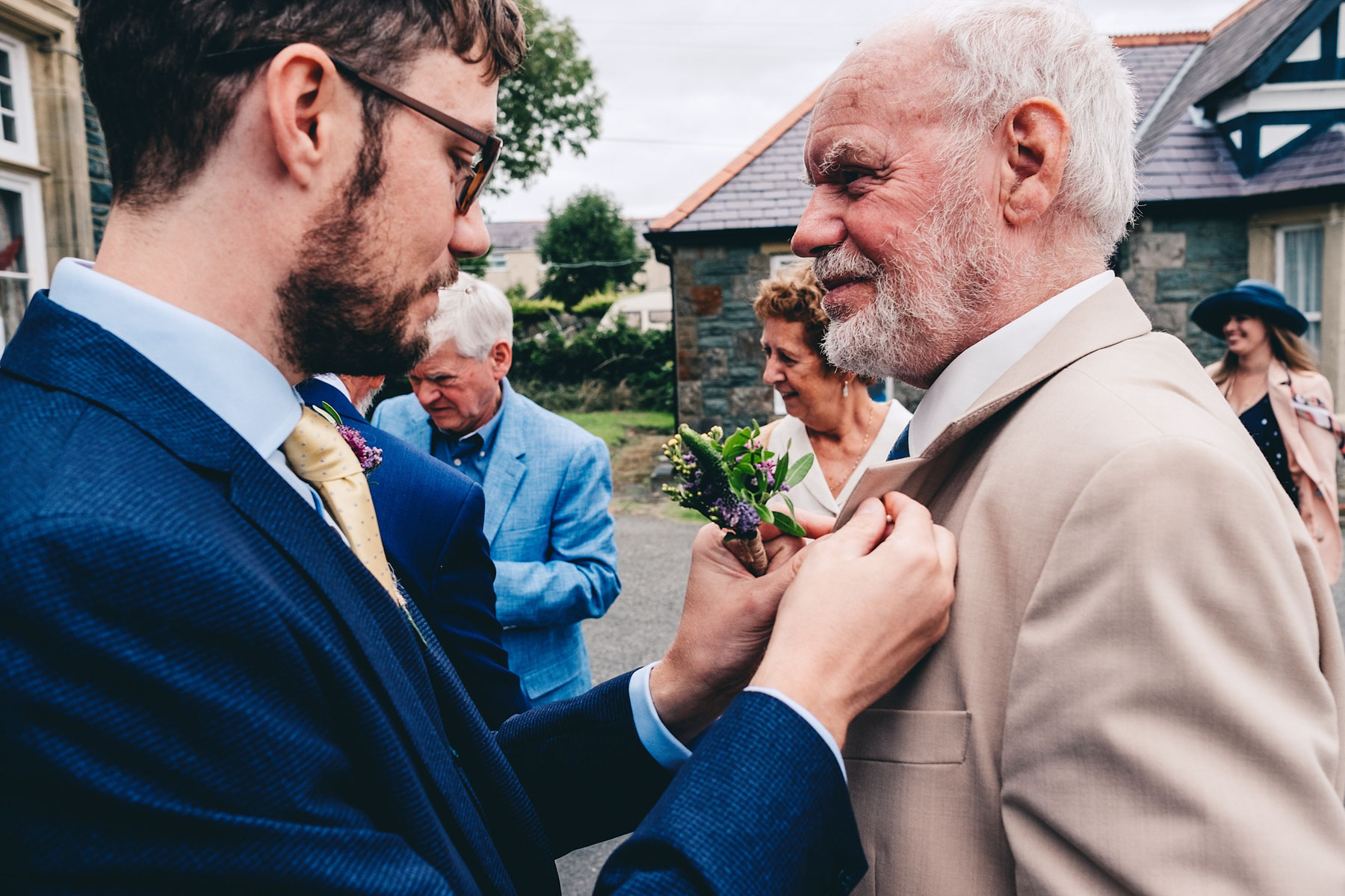Son fixes father of the grooms buttonhole