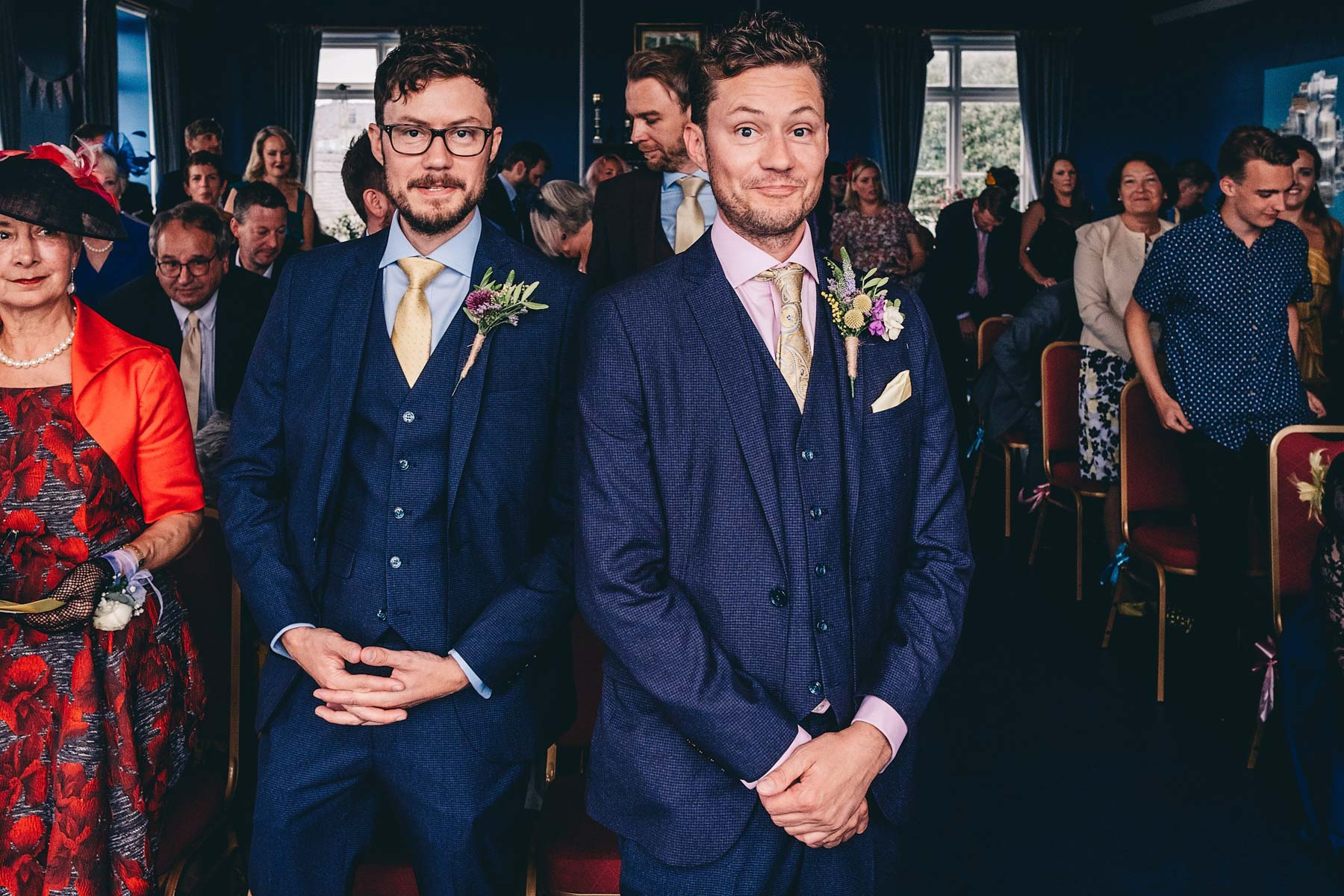 Groom and best man wait nervously for wedding to start