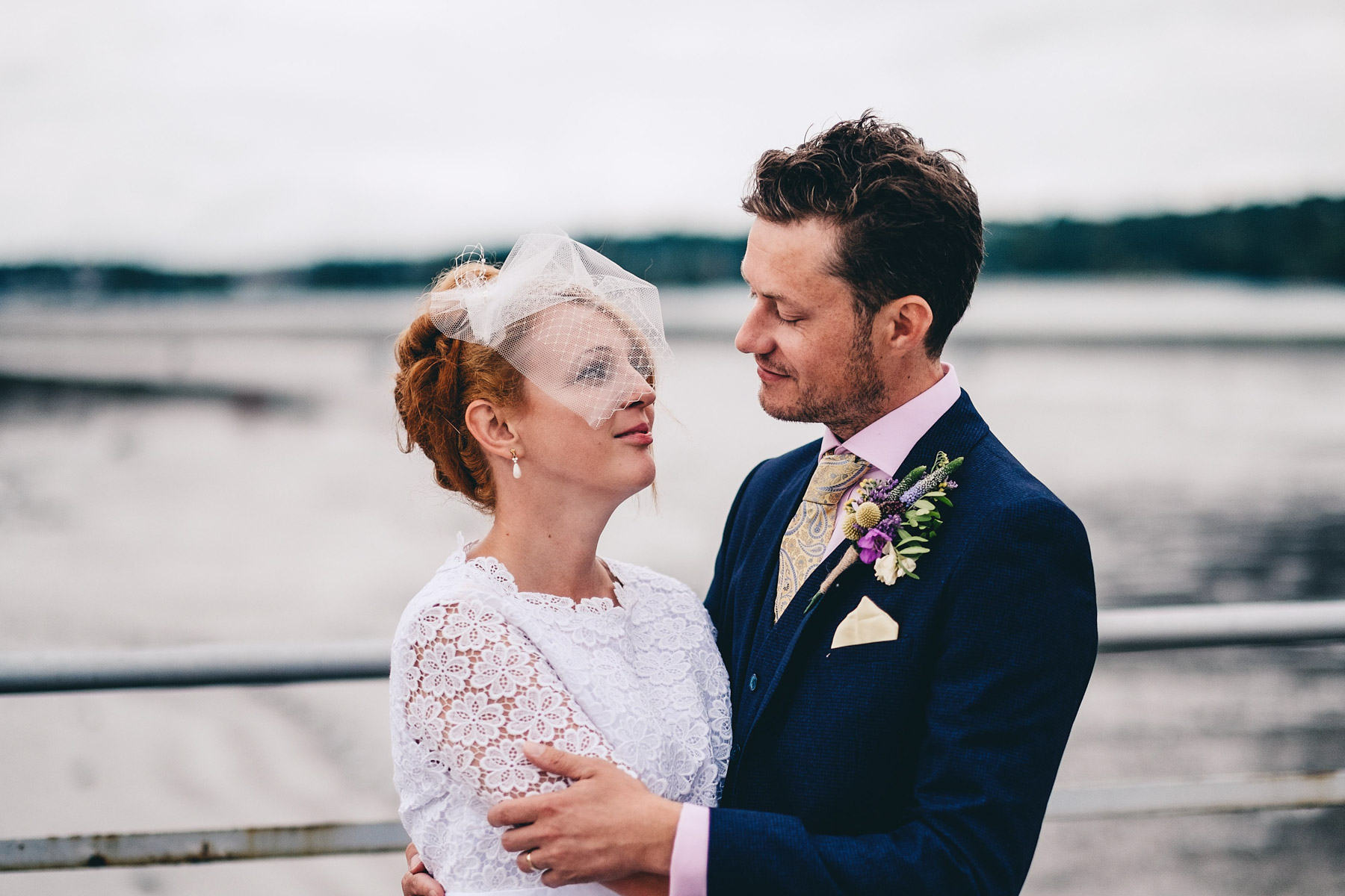 Bride and groom look lovingly at each other at Bangor Garth Pier