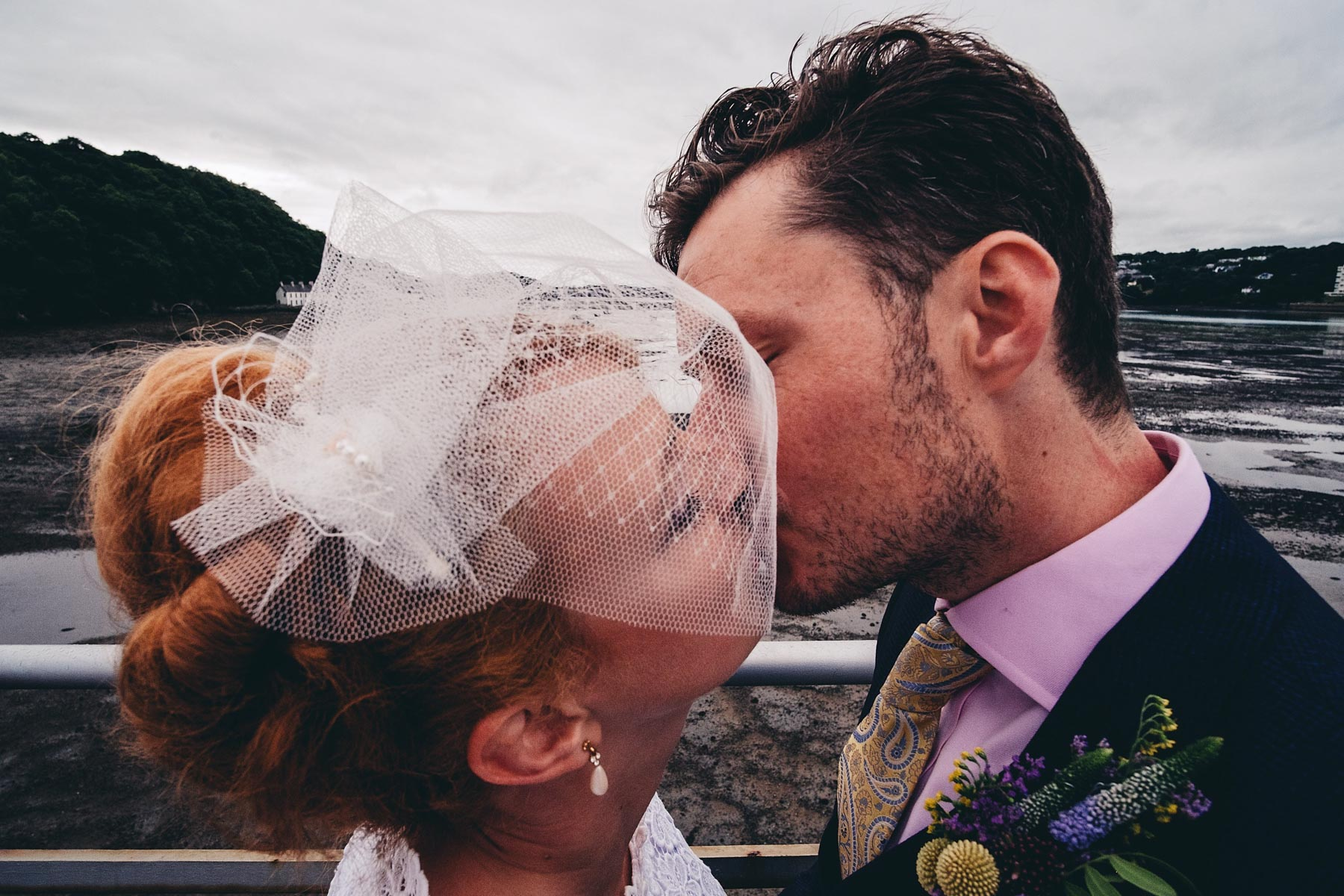 Bride and groom kiss on Bangor Garth Pier