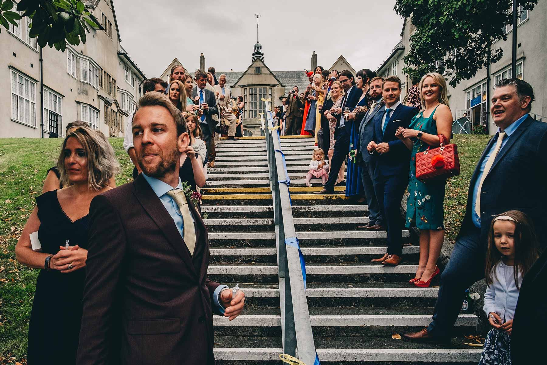 Guests wait on steps to congratulate bride and groom