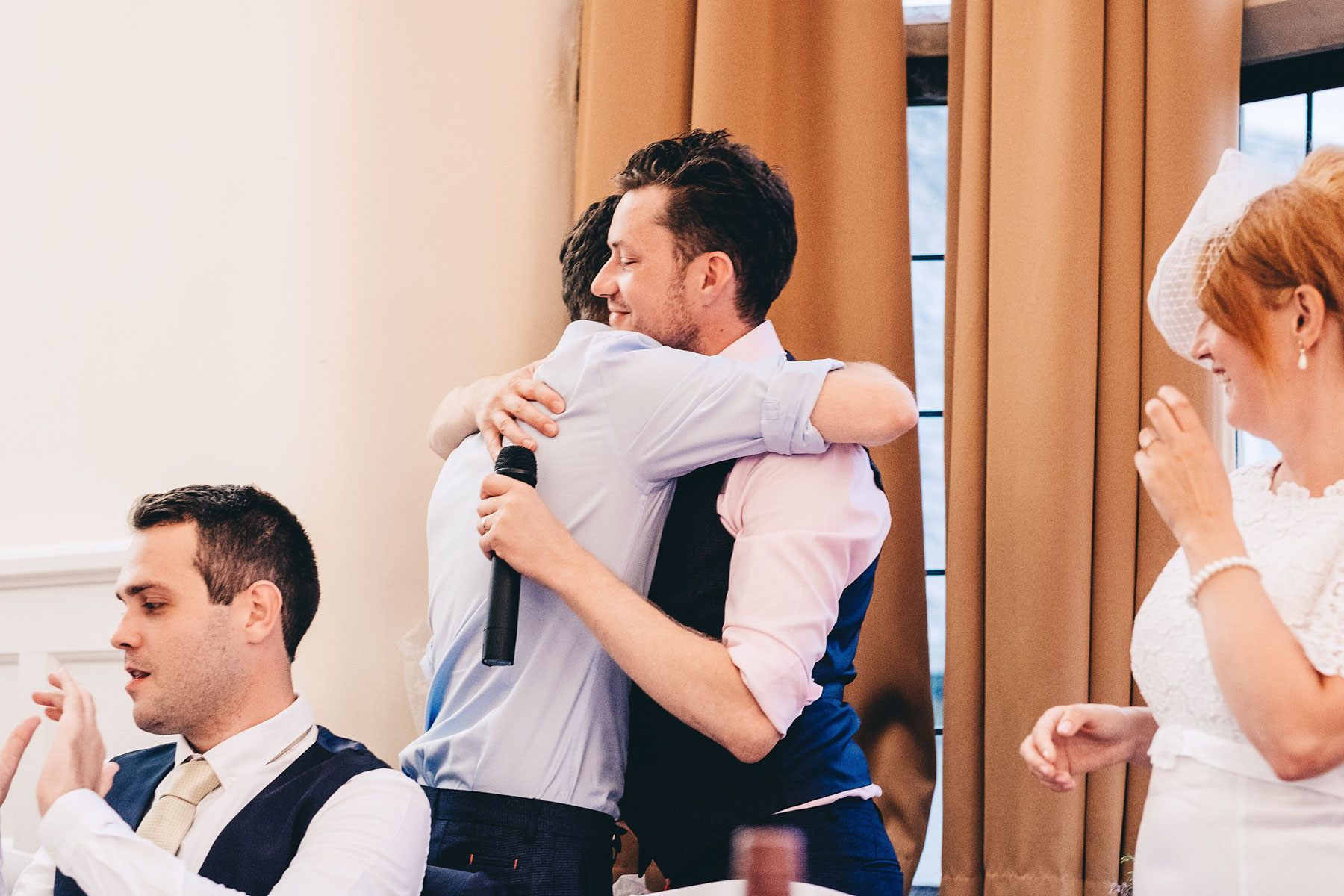 Groom hugs best man after speech