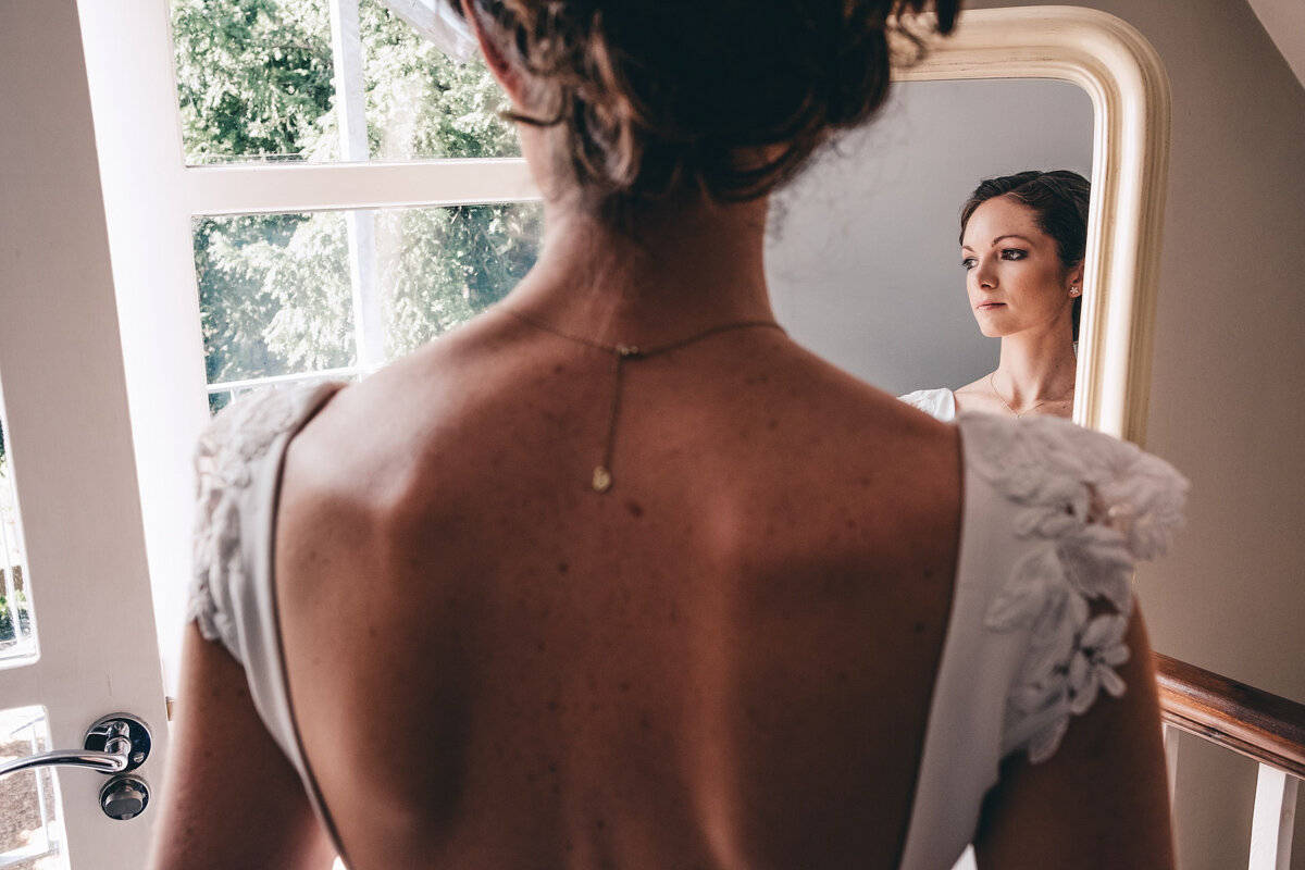 Bride in front of mirror looking stylish