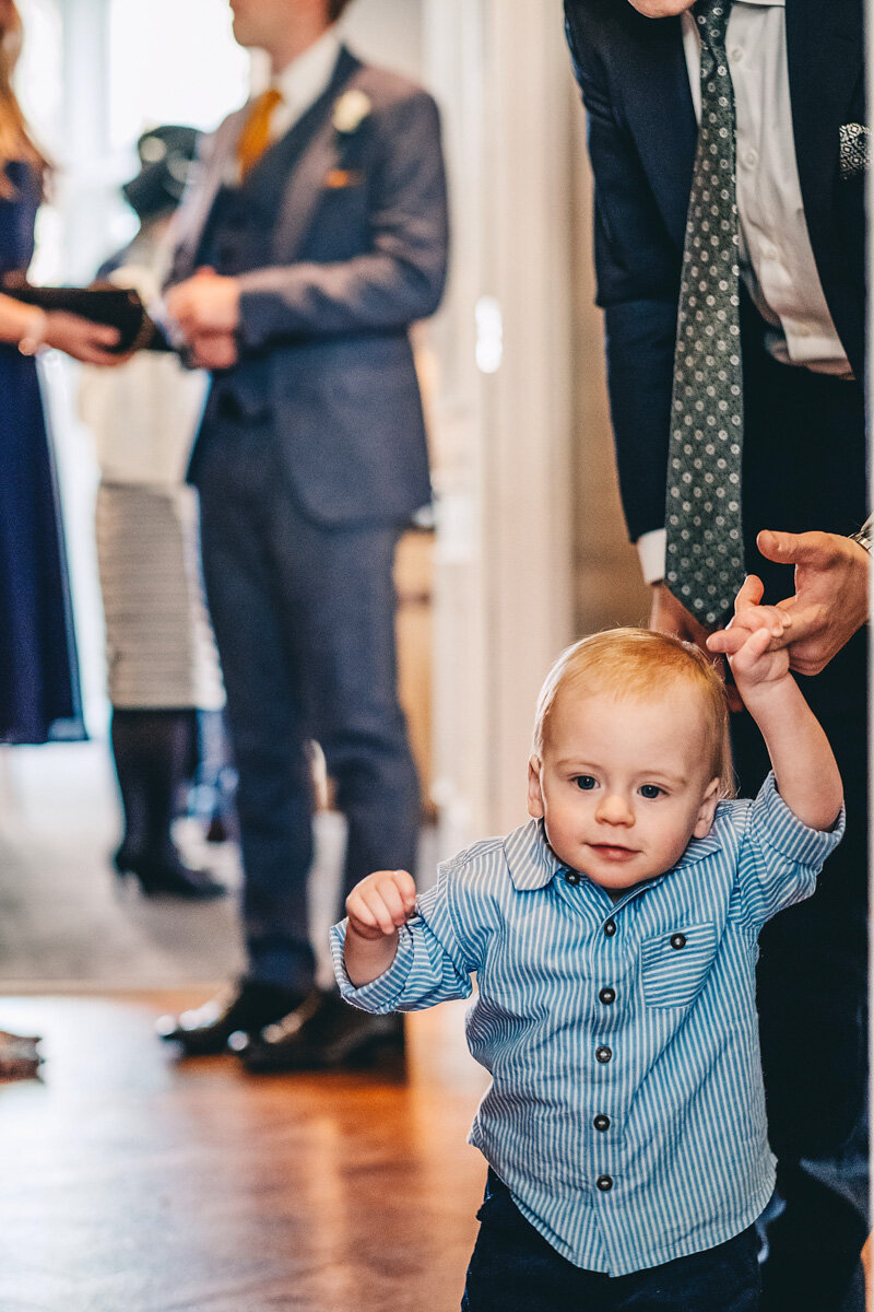 Young child tries to walk during wedding evening