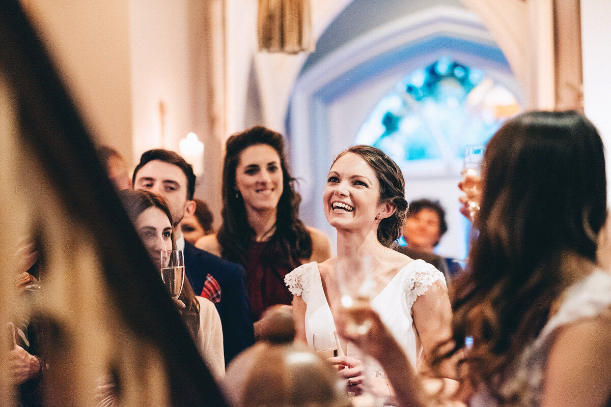 Bride laughs at grooms speech during their wedding