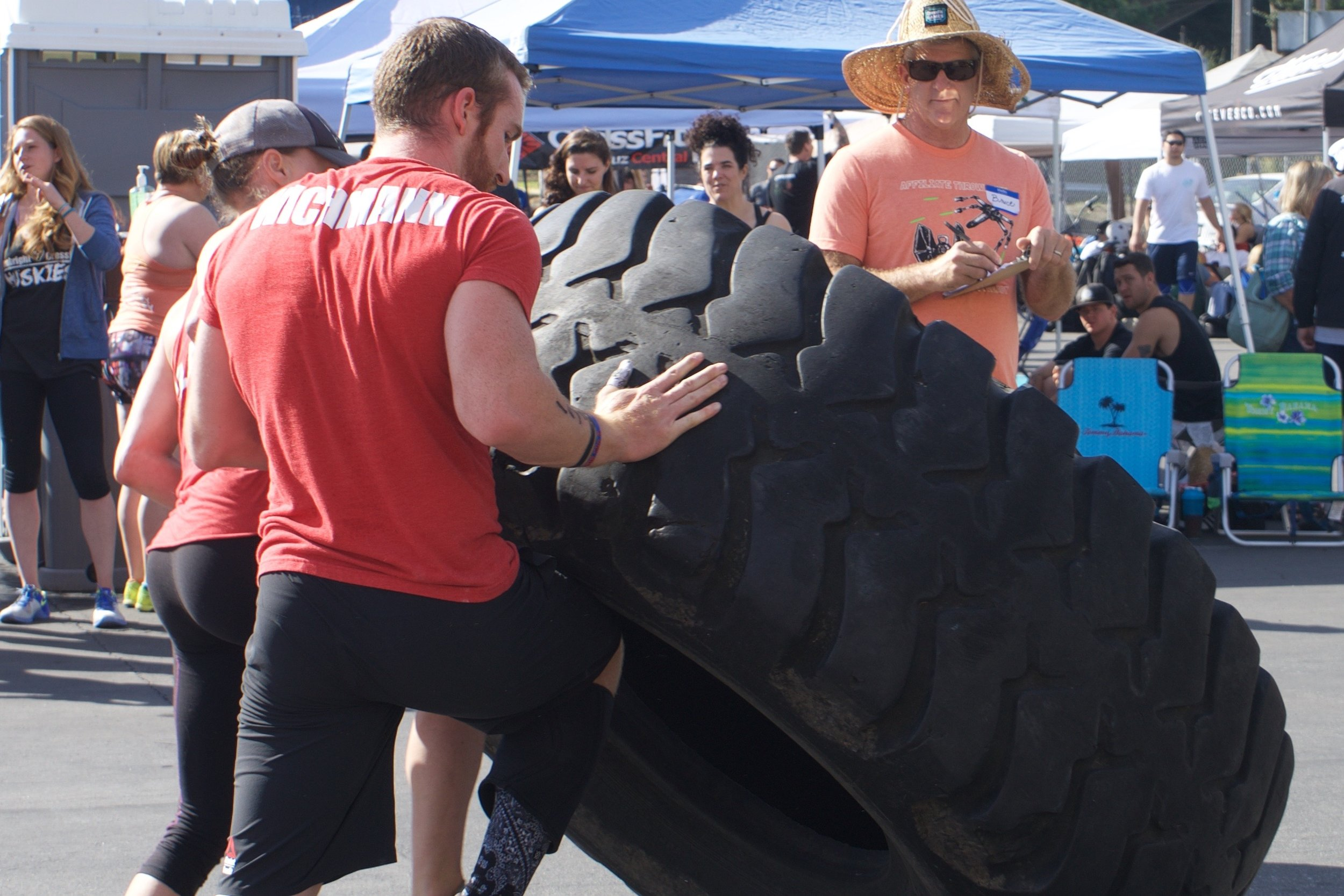 Chris Wichmann and Larie Galassi from CrossFit Santa Cruz flipping the monster tire.
