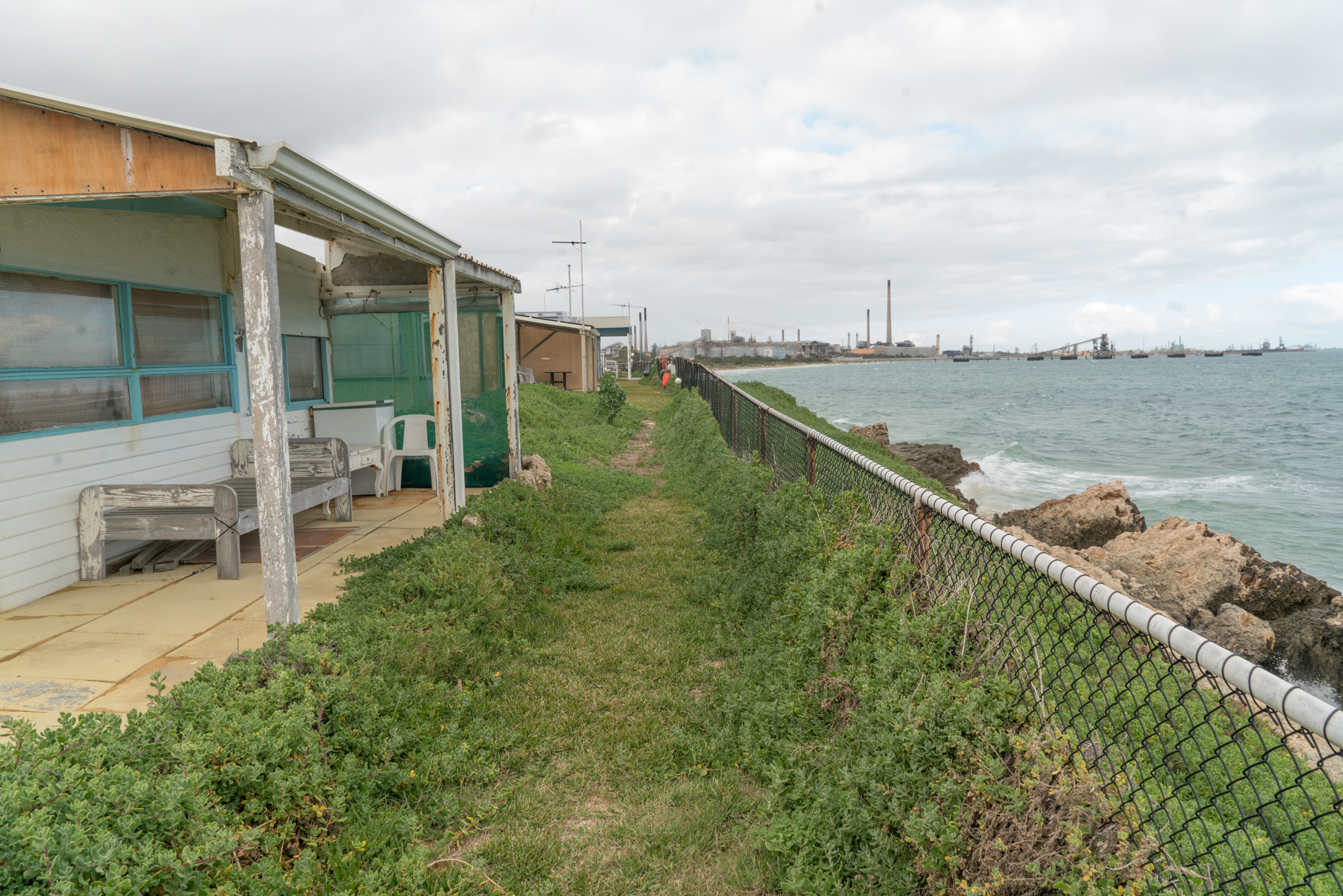 Plate 19: Narrow coastal path between some of the shacks and the fence