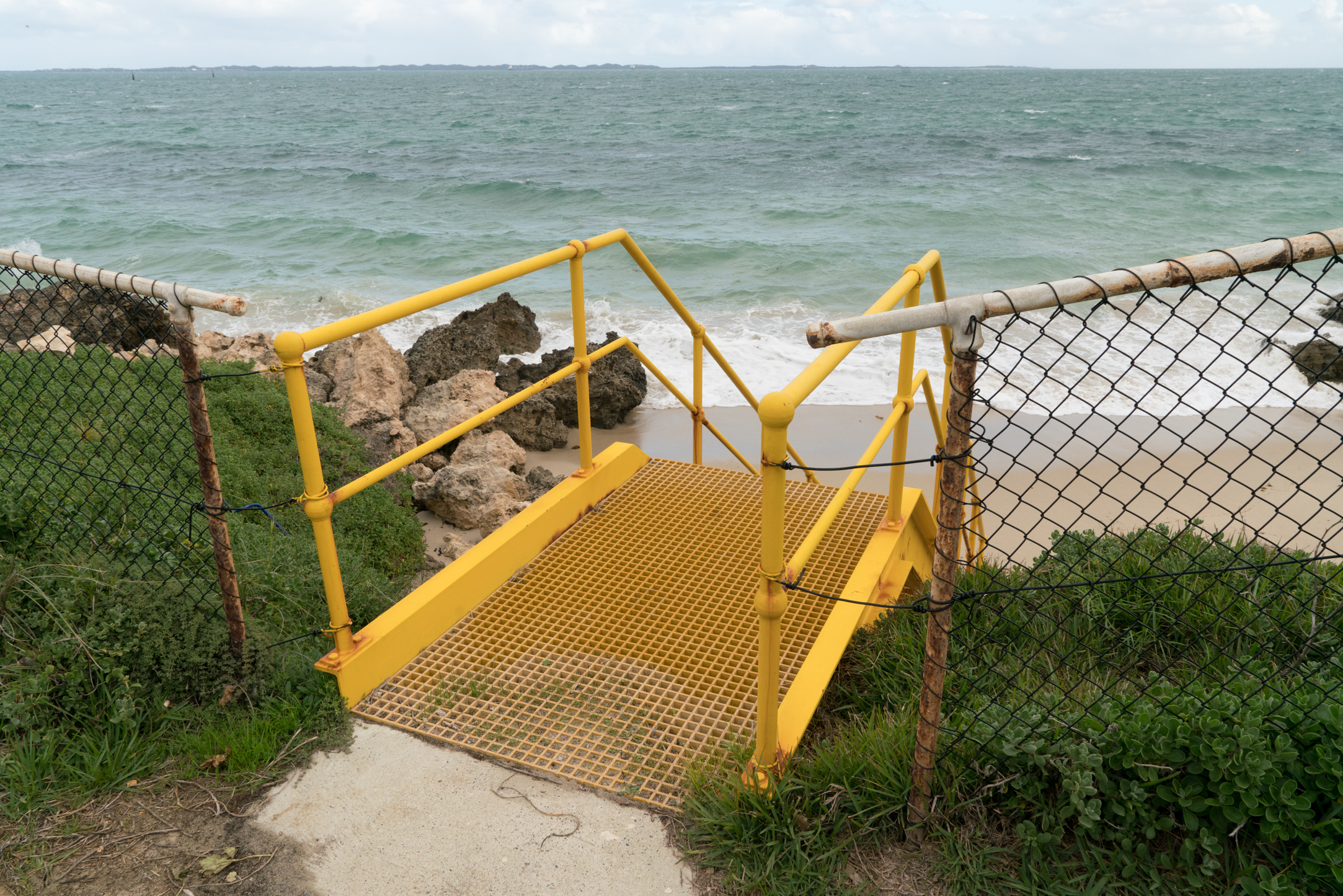 Plate 20: Steps down to one of the small beaches