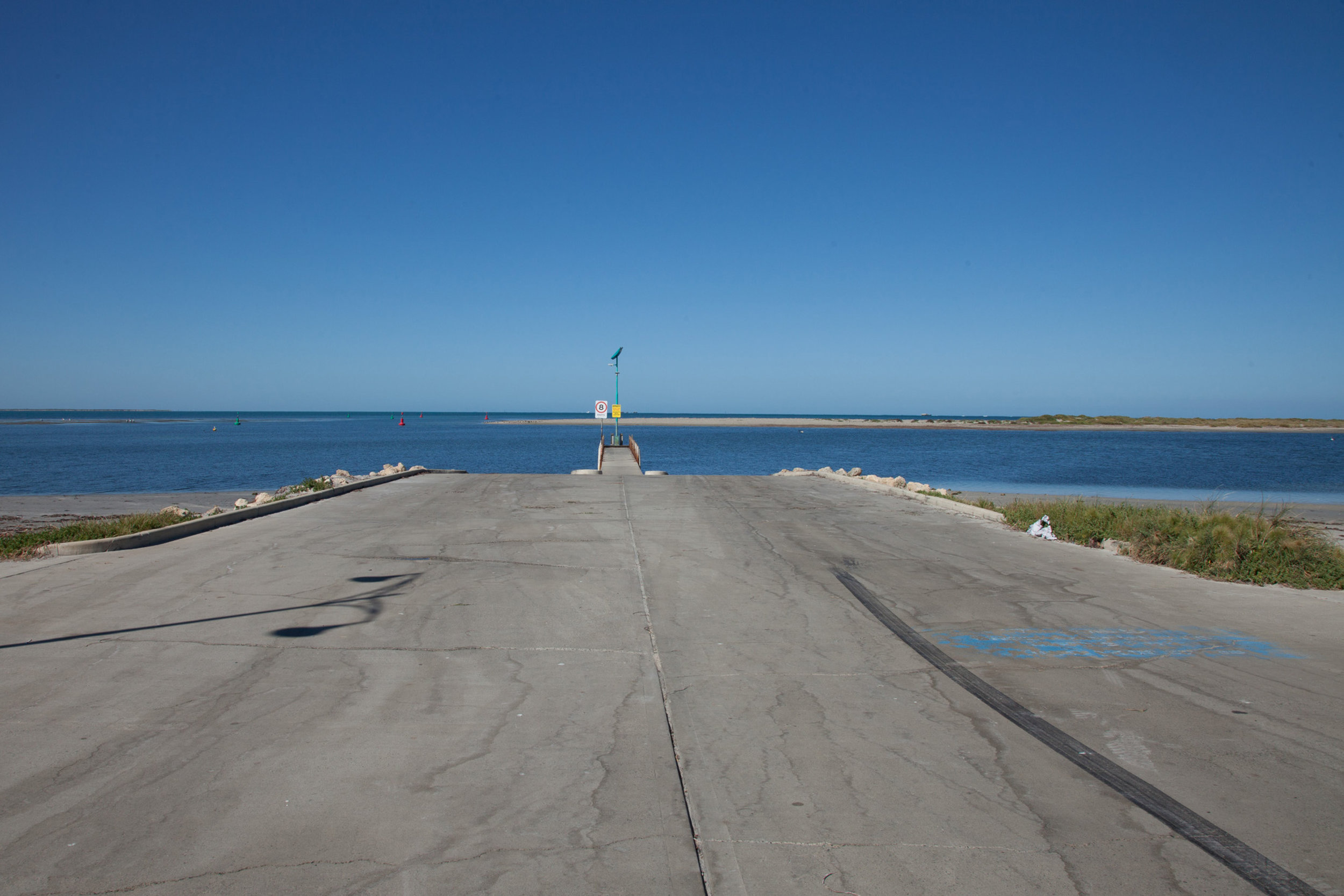 Plate 3: Boat ramp at the end of Brent Street. The dredged channel between the end of Tern Island and the sand bar is visible.