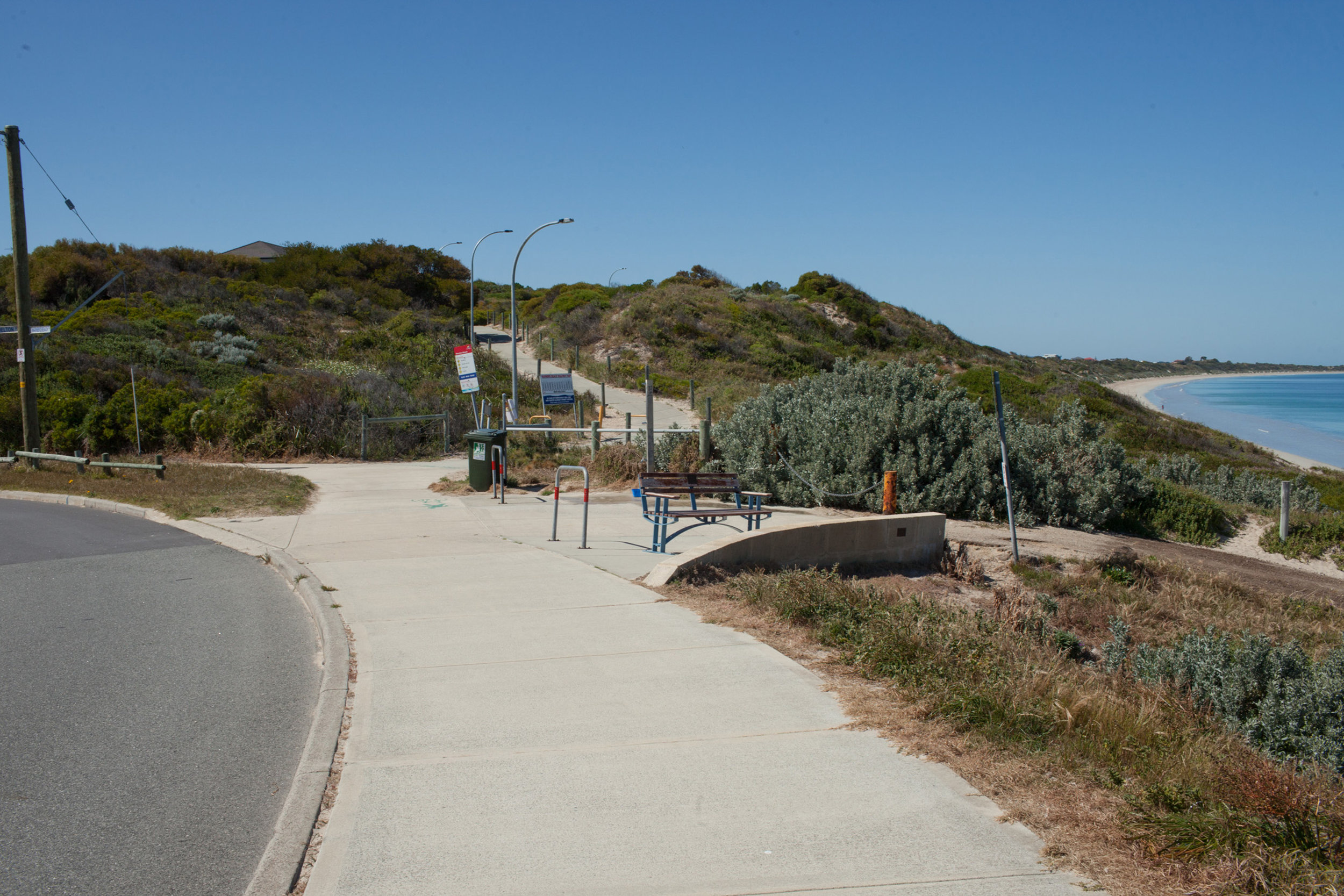 Plate 10: End of the walk showing the road bending left and the increased coastal setbacks.