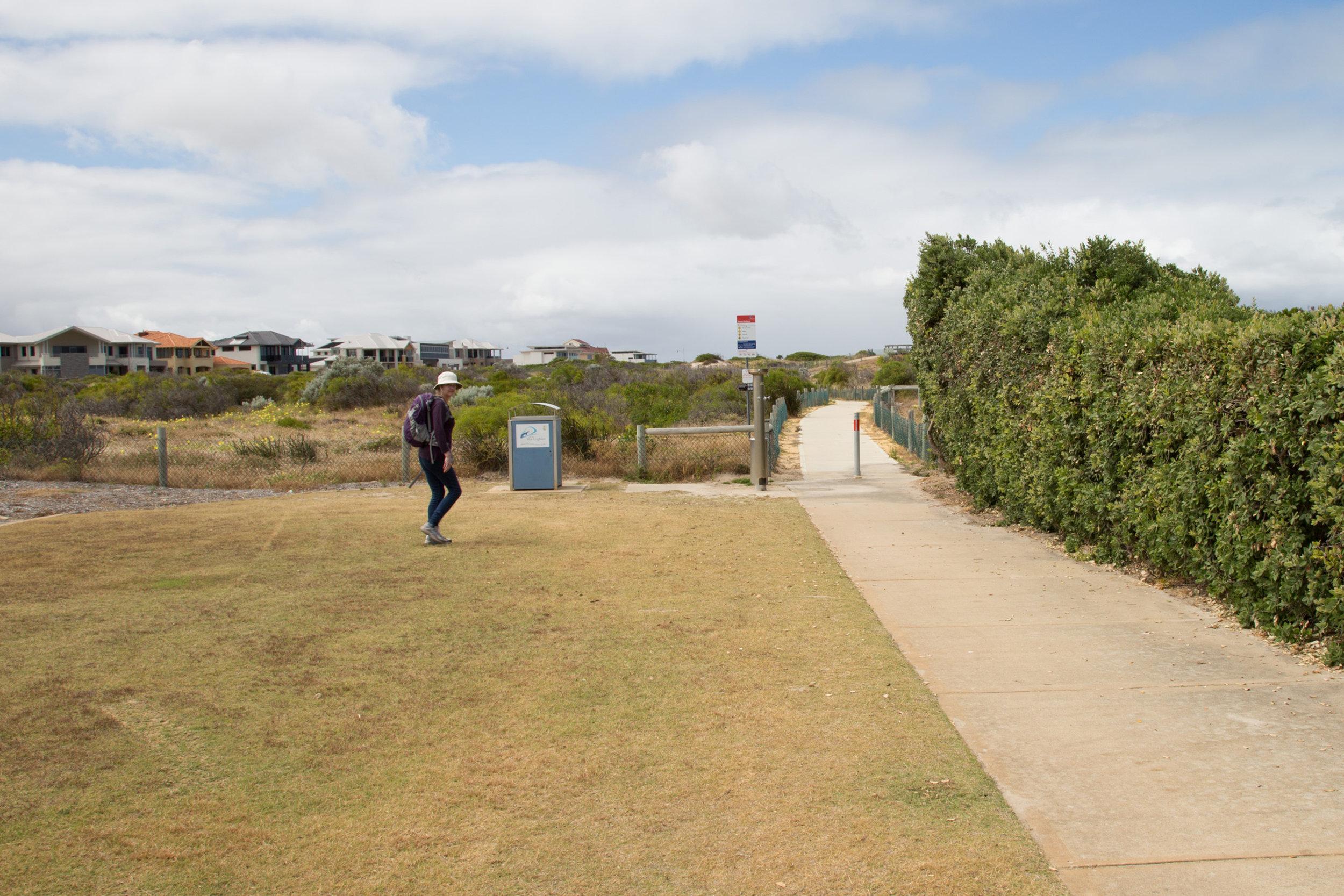 Plate 4: Concrete path at the south-western end of the Secret Harbour Beach carpark.