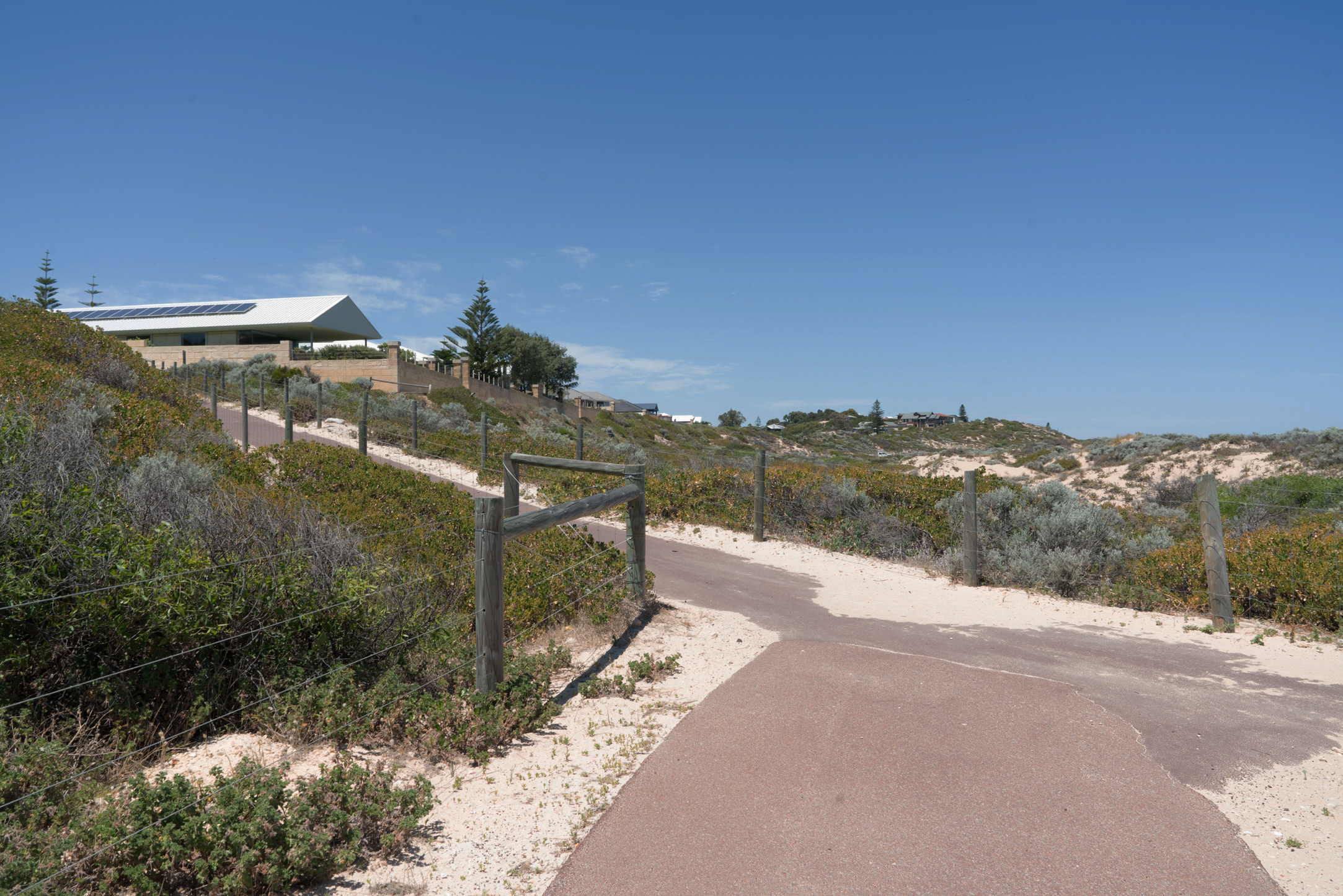 Plate 5: End of the coastal path, and the path up to the Melros residential area
