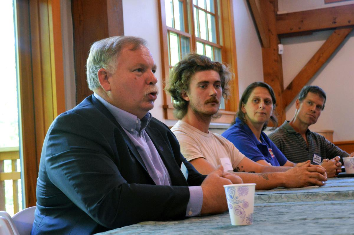 Shawn jasper, NH Commissioner of agriculture addresses concerns of local farmers. Pictured righ to left (Commissioner Jasper, Jack Rixey of TRACies community farm, Beth Hodge of echo farm puddings and bruce wooster of picadilly farm.
