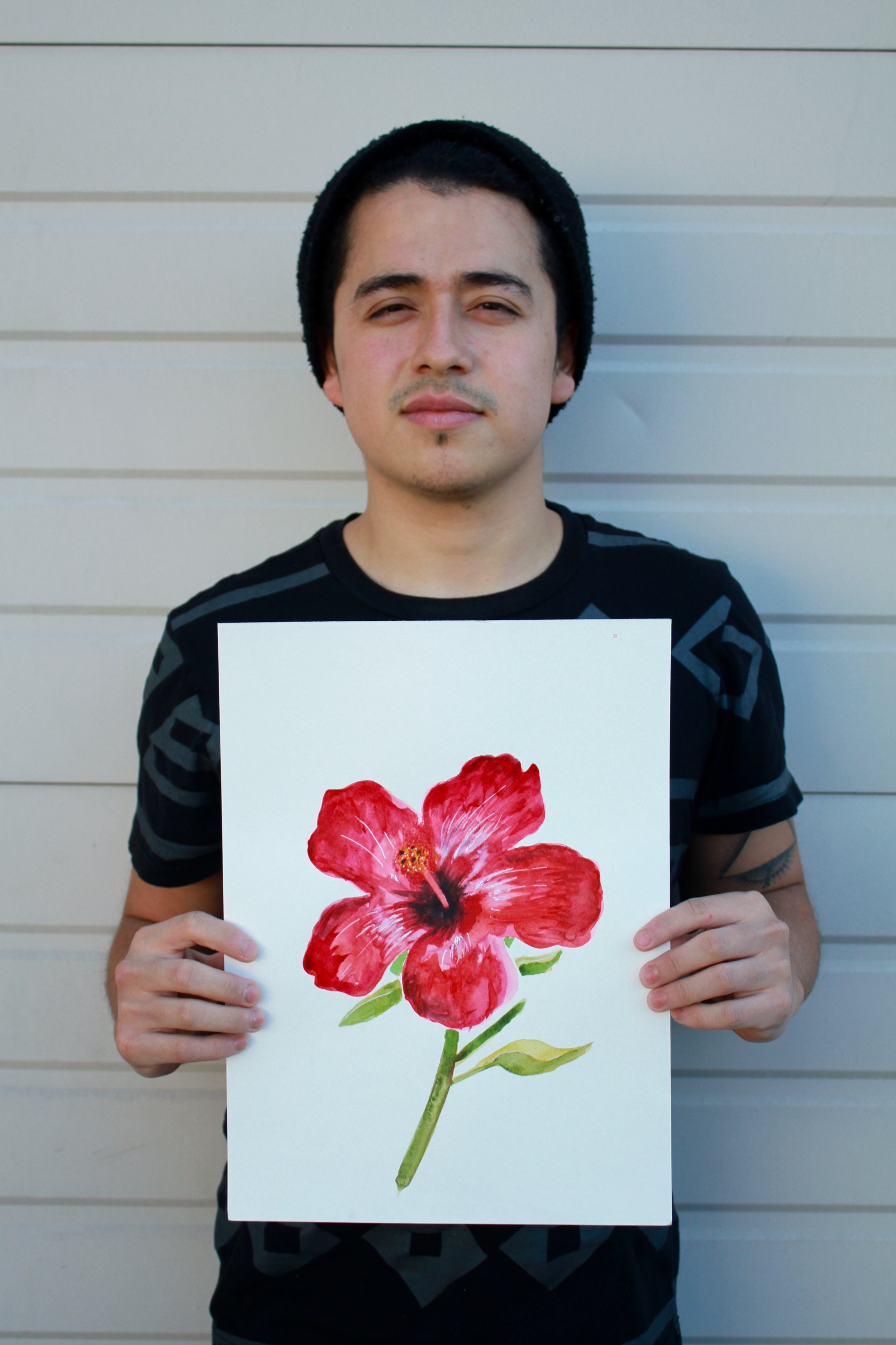 Idhael with his favorite illustration, the HIbiscus Flower from our  Hibiscus Cooler