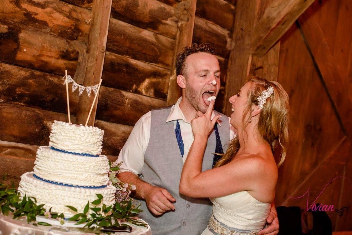 bride-feeding-groom-cake-on-wedding-day.jpg