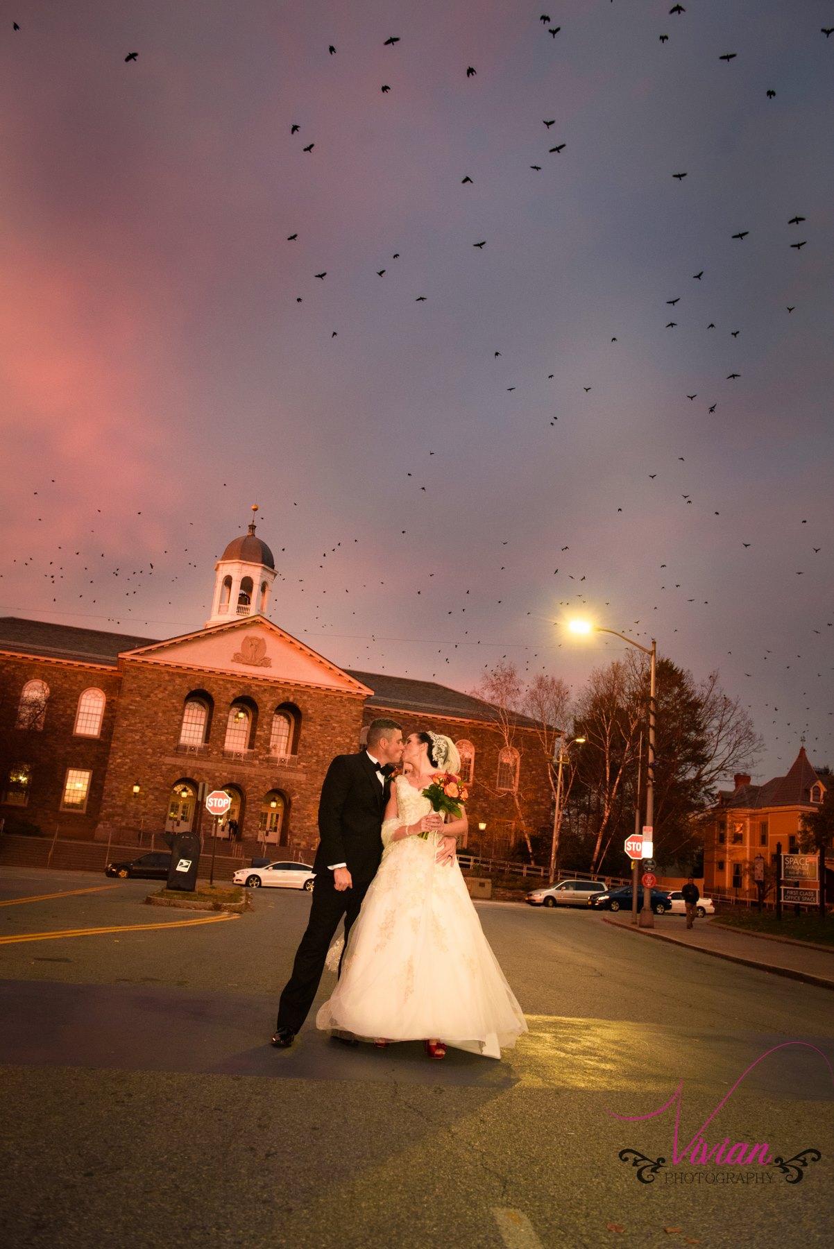 bride-and-groom-kissing-birds-flying-overhead.jpg