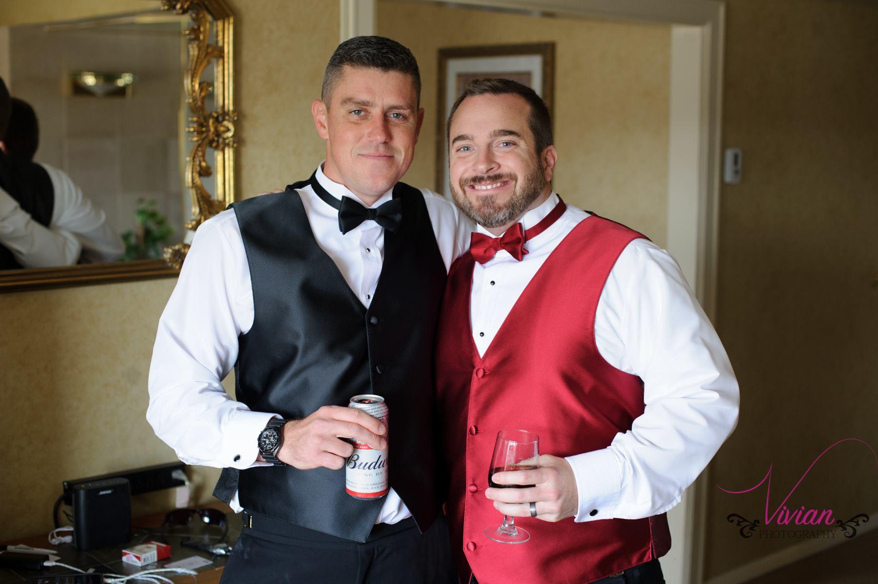 groom-and-bestman-posing-with-beer-cans.jpg