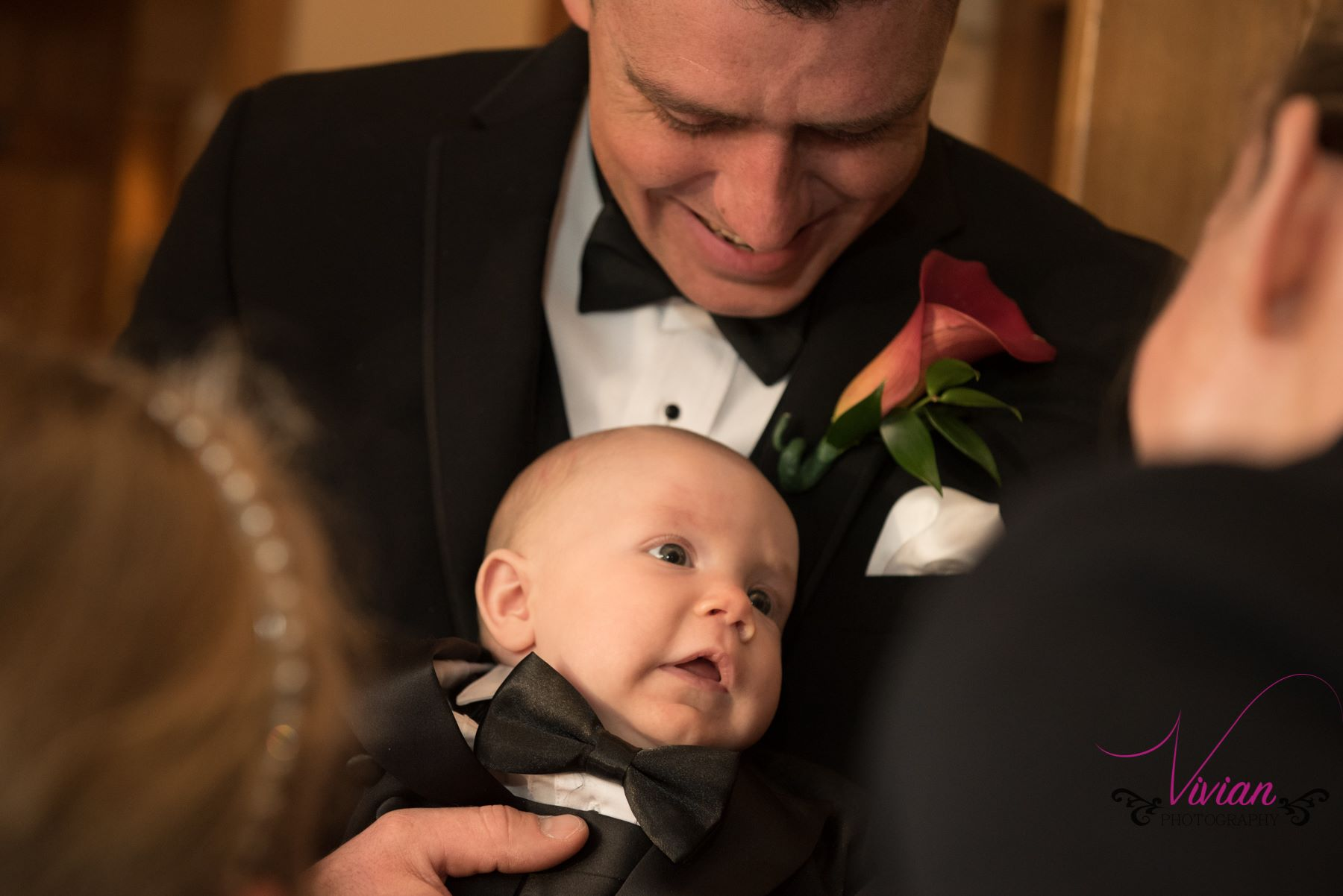 groom-looking-down-at-baby.jpg