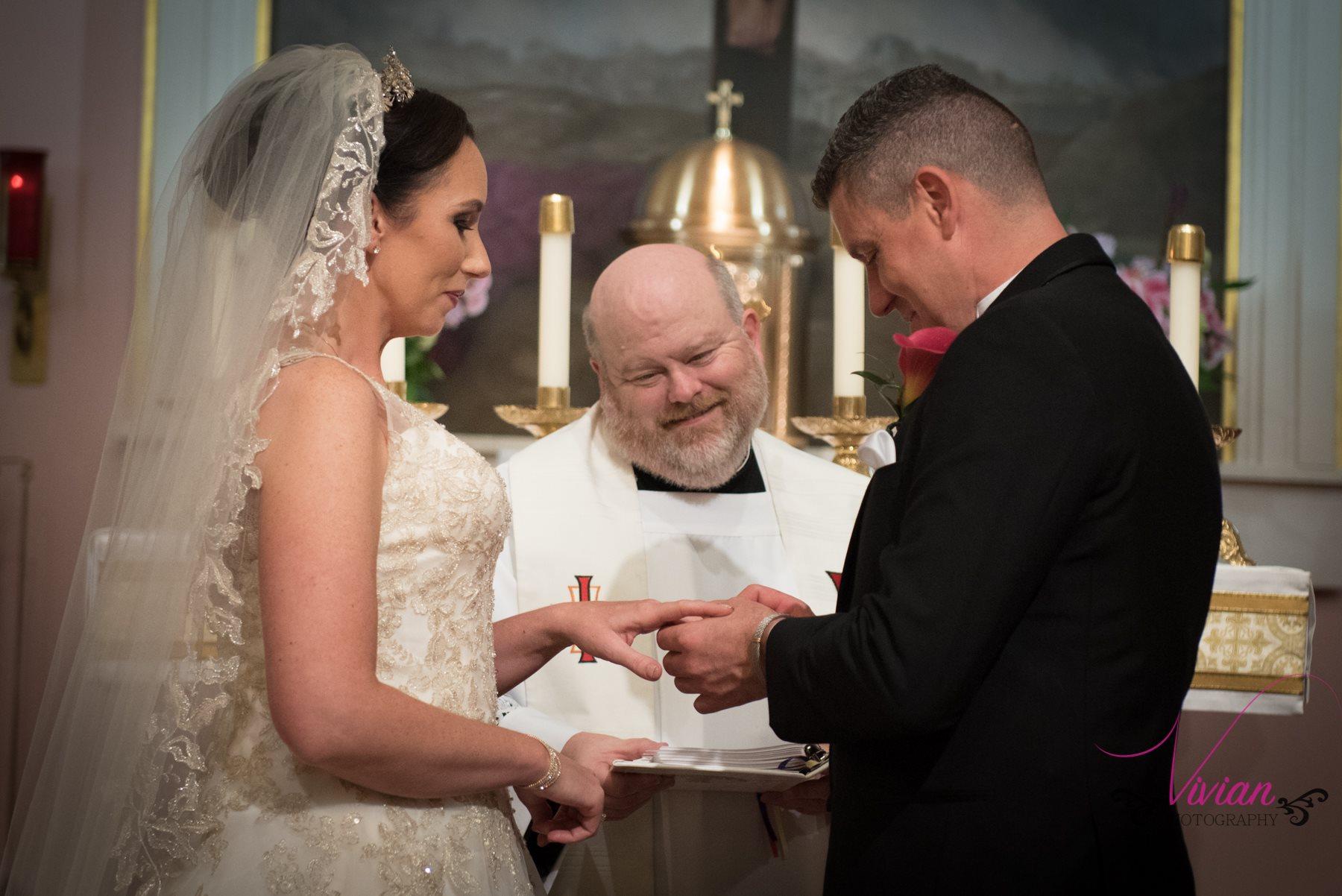 groom-putting-ring-on-bride.jpg