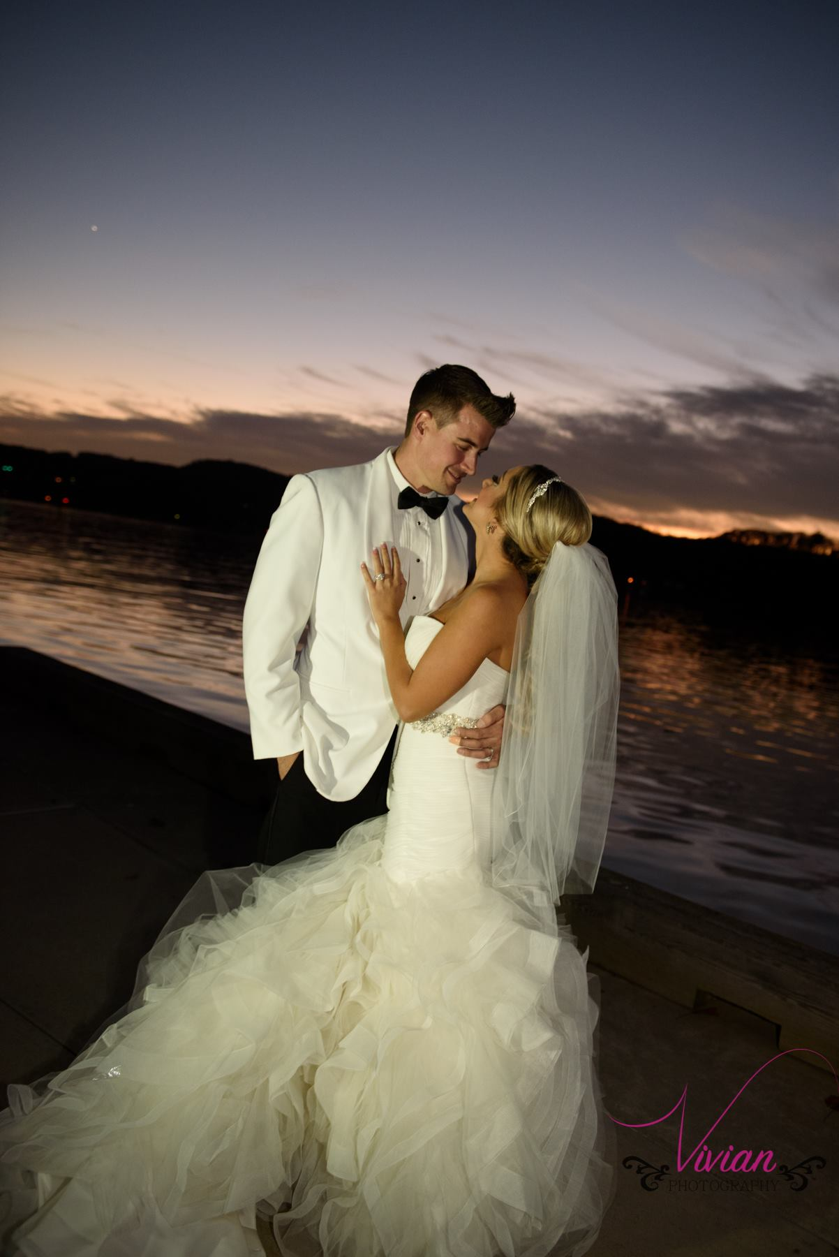 bride-and-groom-kissing-in-sunset.jpg