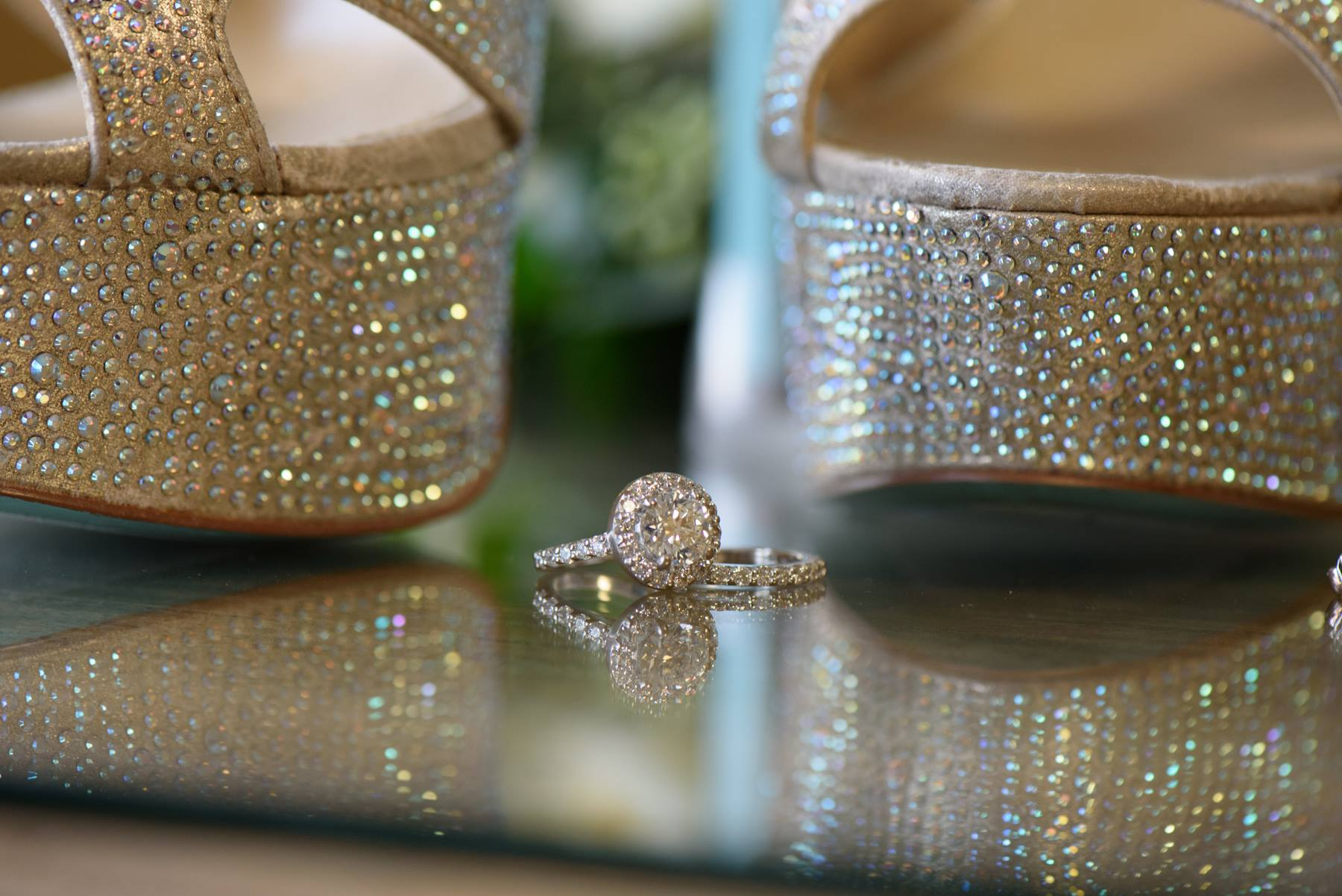 wedding-rings-sitting-between-bejeweled-heels.jpg