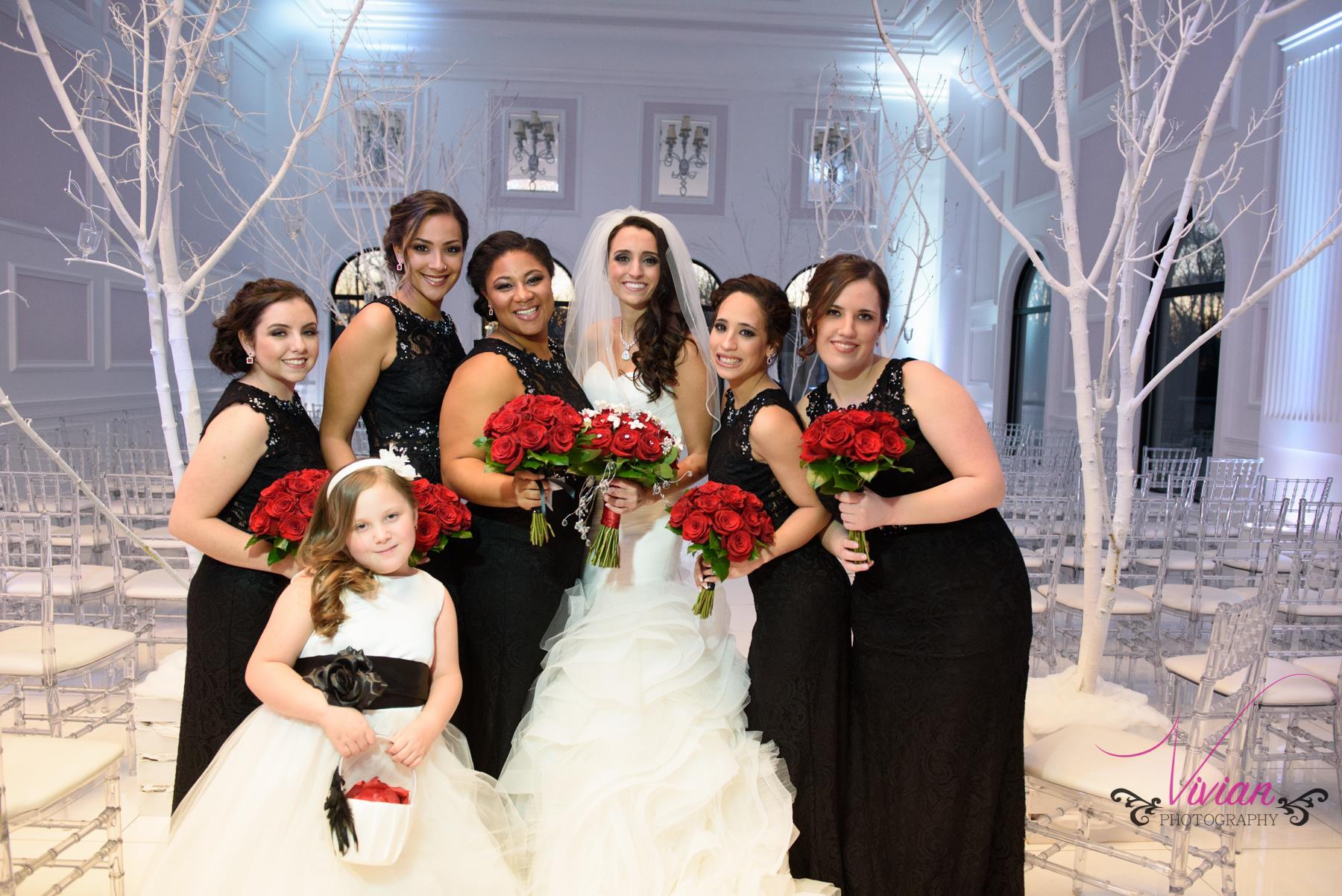 bride-posing-with-bridesmaids-in-winter-wedding-theme.jpg
