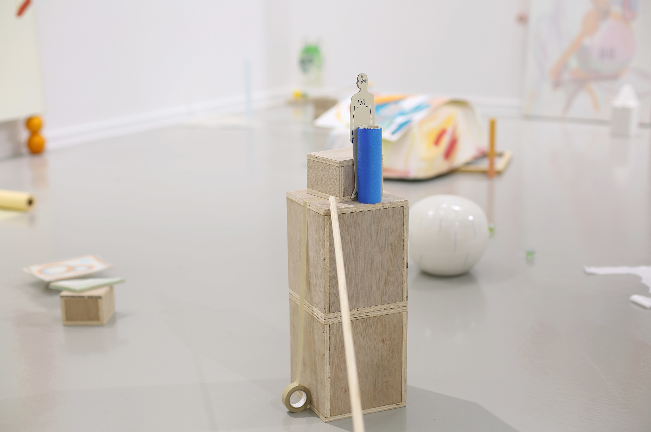 Man in crisis    2019, Rolled painting, ready-made object, masking tape, wood box, wood stick, orange, Dimensions variable