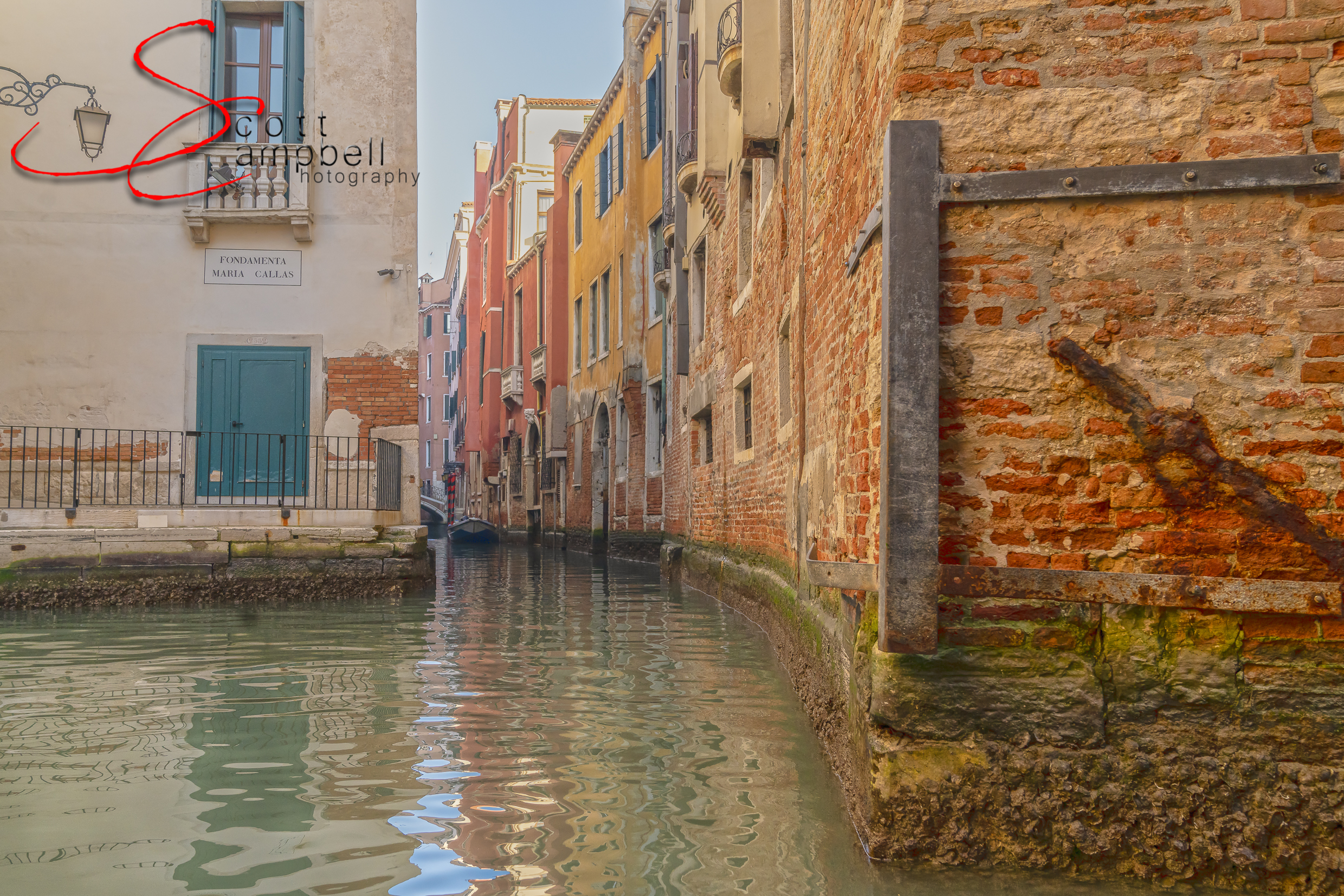 One of the many beautiful canals and ancient Venice buildings.