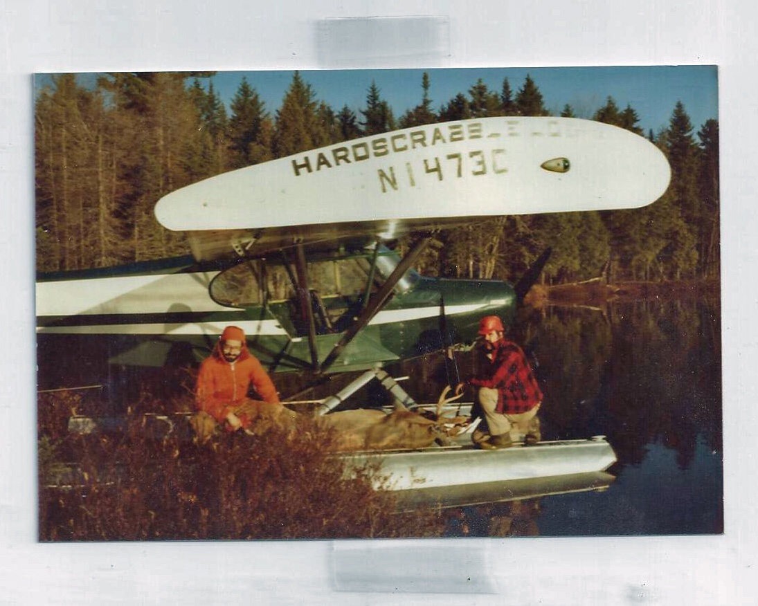 Jake preparing to fly a large deer out of Roaring Brook pond in the Super Cub.