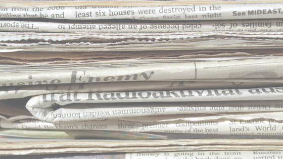 stack of newspapers.png